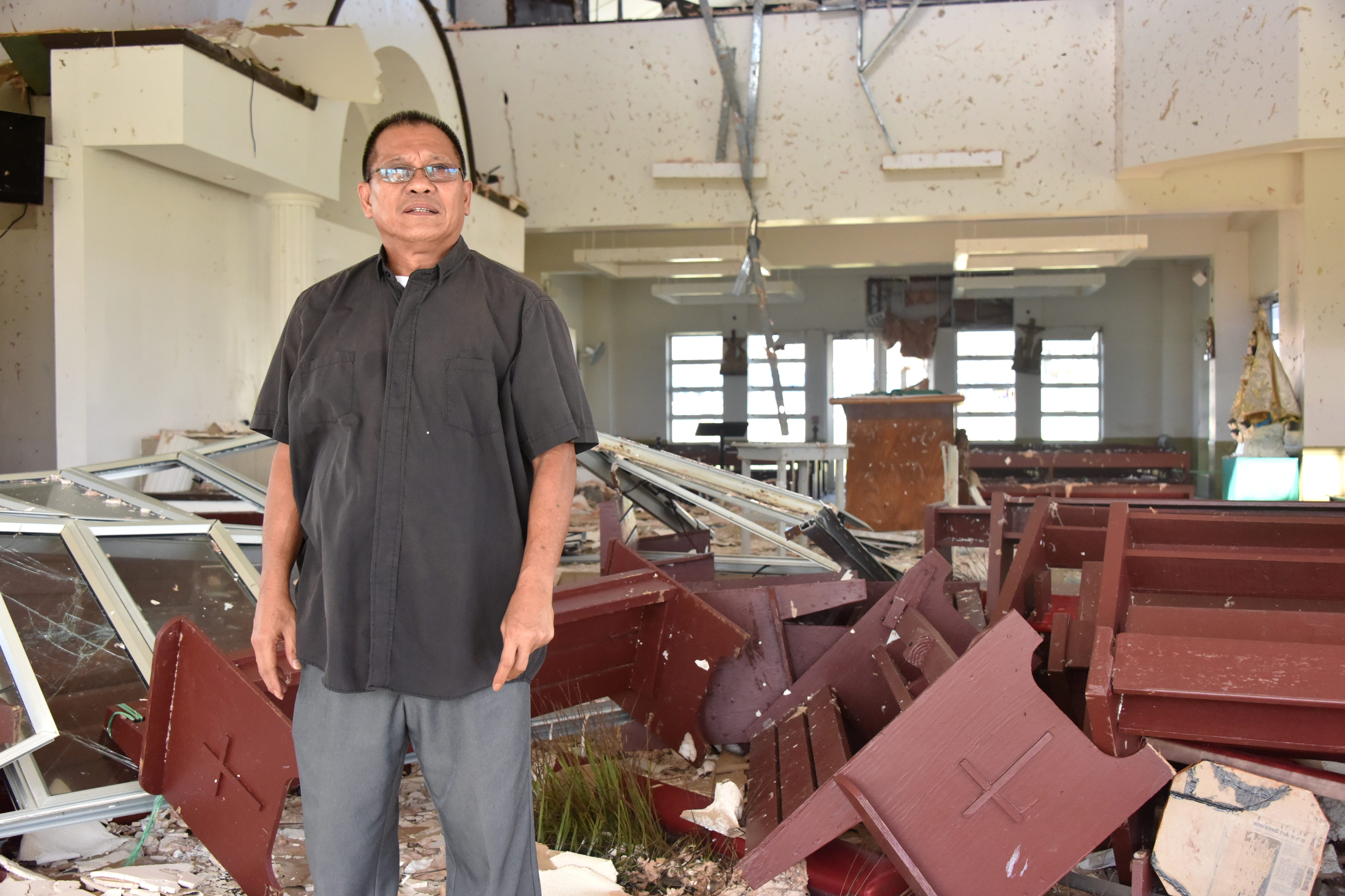 Father Rey Rosal stands inside Tinian's San Jose Catholic Church on Nov. 3, 2018 The island's only church was destroyed by Super Typhoon Yutu, which struck the island on Oct. 24 and 25.