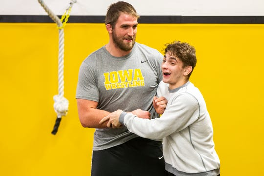 Iowa volunteer assistant coach Bobby Telford (left) jokes around with Austin DeSanto during Hawkeye wrestling media day on Monday, Nov. 5, 2018, inside the Dan Gable Wrestling Complex at Carver-Hawkeye Arena in Iowa City.