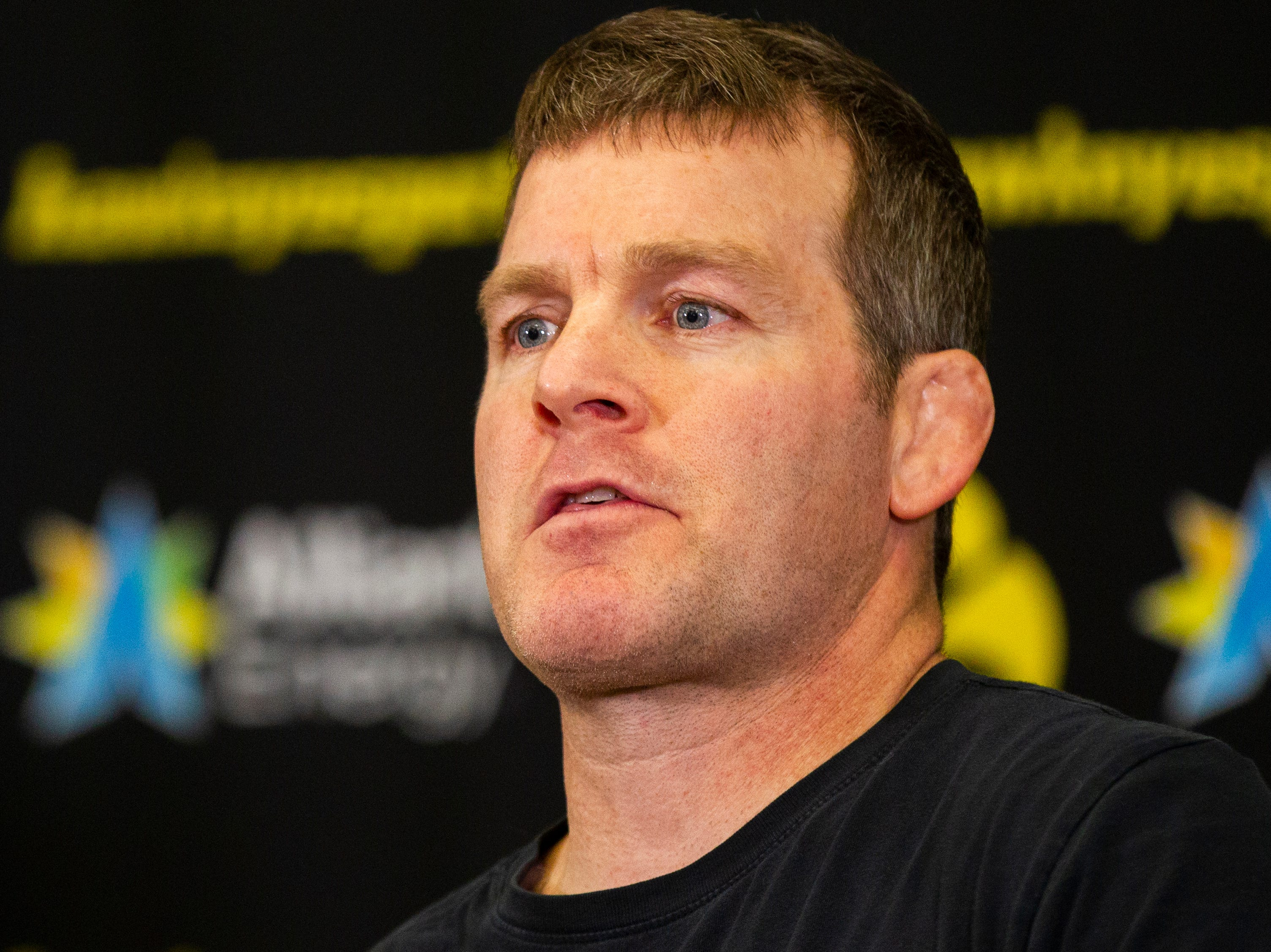 Iowa wrestling head coach Tom Brands talks with reporters during Hawkeye wrestling media day on Monday, Nov. 5, 2018, inside the Dan Gable Wrestling Complex at Carver-Hawkeye Arena in Iowa City.