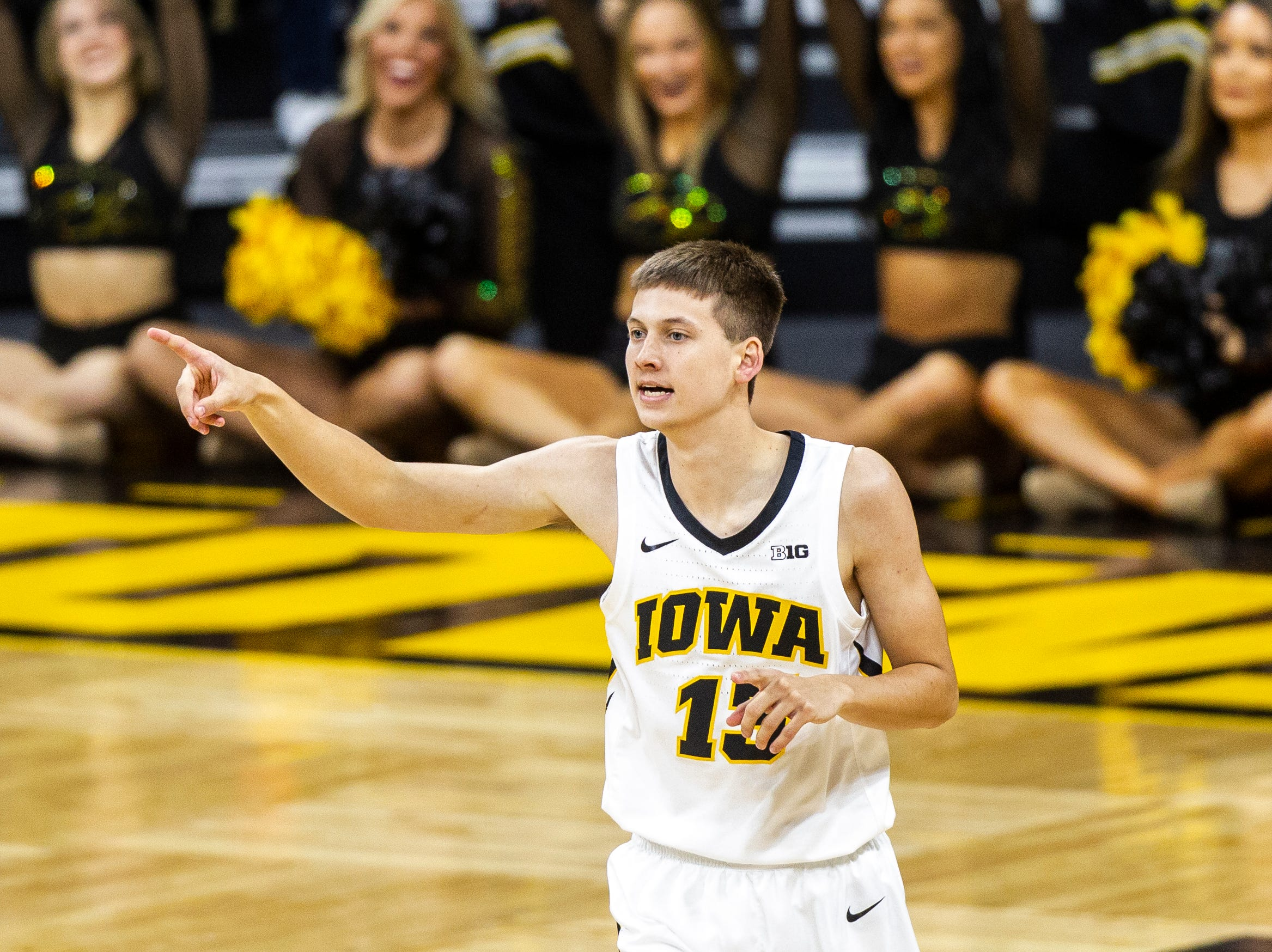 Iowa guard Austin Ash (13) reacts after hitting a 3 during a men's basketball exhibition game on Sunday, Nov. 4, 2018, at Carver-Hawkeye Arena in Iowa City.