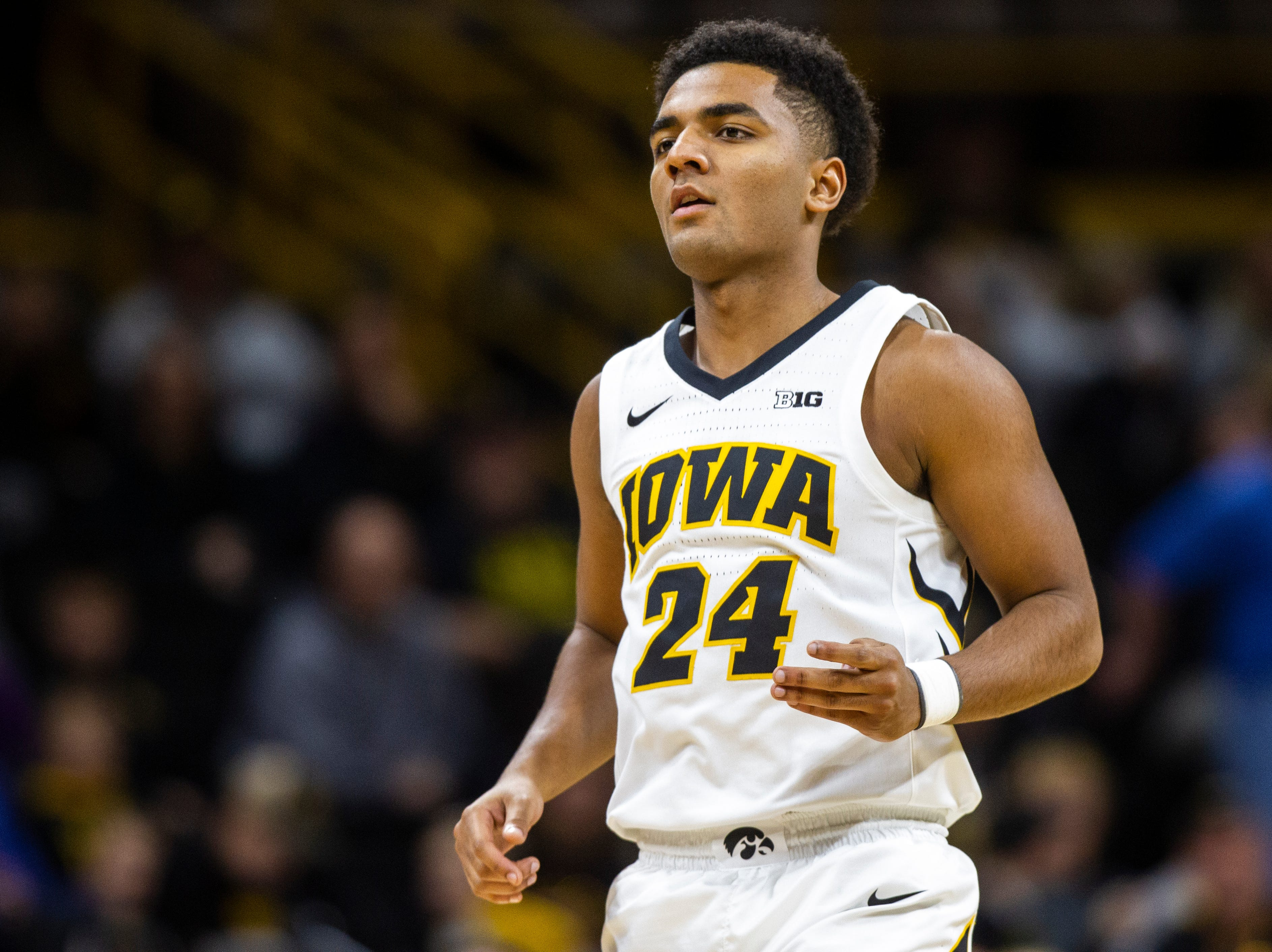 Iowa guard Nicolas Hobbs (24) jogs backwards during a men's basketball exhibition game on Sunday, Nov. 4, 2018, at Carver-Hawkeye Arena in Iowa City.