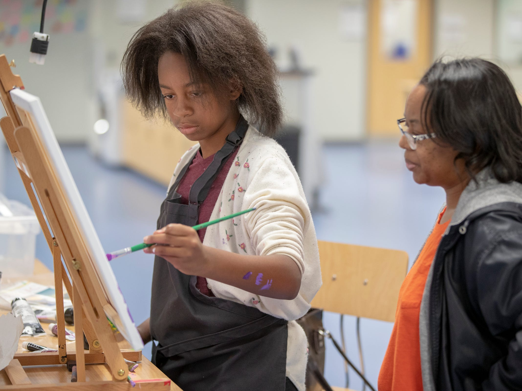 Amora Dues, 11, Fishers, works on a painting as her mother Cherie Dues watches, at Ignite, a new shared work space for artists and creative people at Hamilton East Public Library in Fishers, Sunday, Nov. 4, 2018. The facility is open during regular open hours and has spaces for pottery, videography, 3D printing, and a host of other activities.