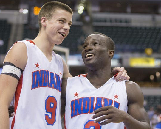 Indiana All-Stars Sean McDermott, left,   of Pendleton Heights, and Joel Okafor of Richmond, enjoy a moment after defeating the Kentucky All-Stars on June 13, 2015.