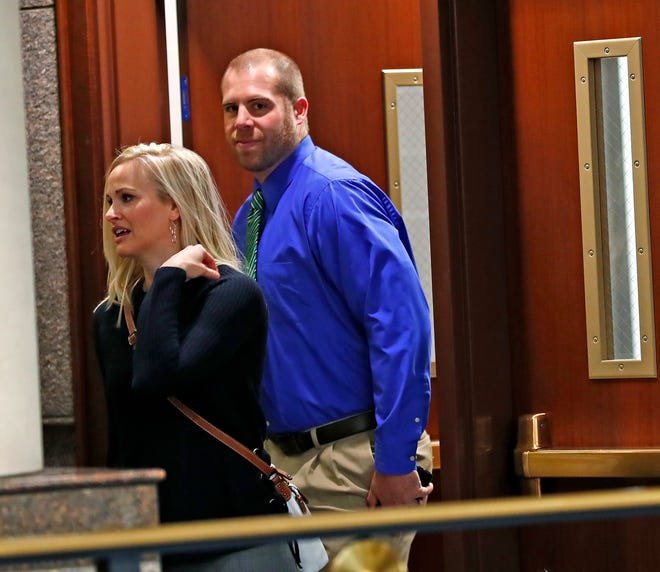 Jason Seaman, right, the seventh grade teacher who was shot three times and is credited for helping to stop the attack in the Noblesville West Middle School shooting, heads to court for the disposition hearing for the shooting suspect, at the Hamilton County Courthouse, Monday, Nov. 5, 2018.