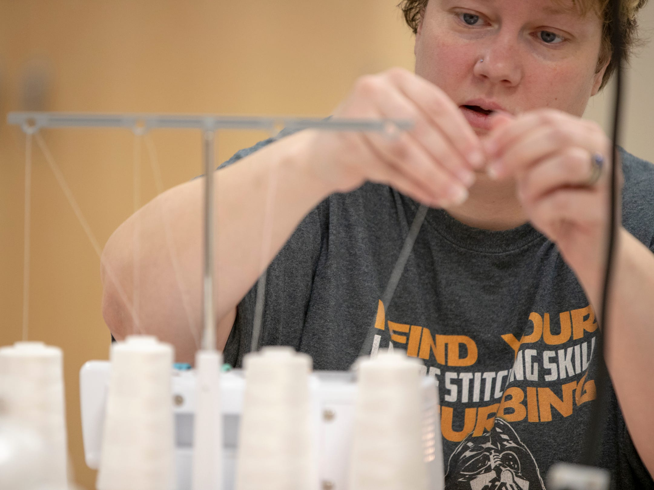 Rachel Anderson, Noblesville, works with a serger, which is helping her make a set of leggings at Ignite, a new shared work space for artists and creative people at Hamilton East Public Library in Fishers, Sunday, Nov. 4, 2018. The facility is open during regular open hours and has spaces for pottery, videography, 3D printing, and a host of other activities.