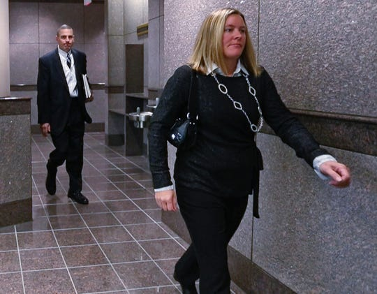 Hamilton County Prosecutor D. Lee Buckingham II, left, and Julia Whistler, mother of Ella Whistler, leave the courtroom after the hearing for the suspect in the Noblesville West Middle School shooting, Monday, Nov. 5, 2018.