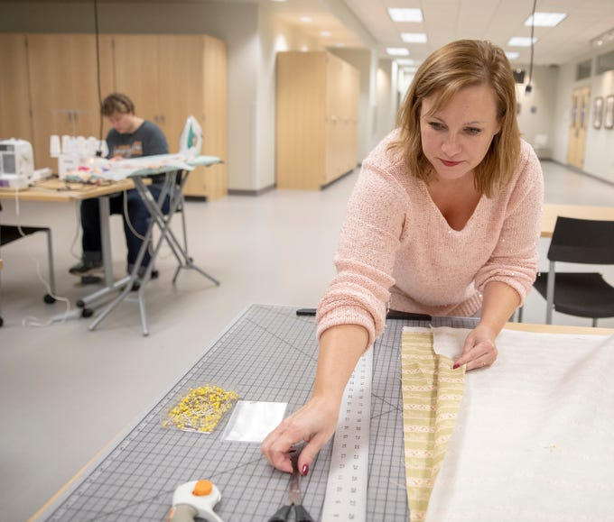 Meredith Miller, Westfield, works on making curtains at Ignite, a new shared work space for artists and creative people at Hamilton East Public Library in Fishers, Sunday, Nov. 4, 2018. The facility is open during regular open hours and has spaces for pottery, videography, 3D printing, and a host of other activities.