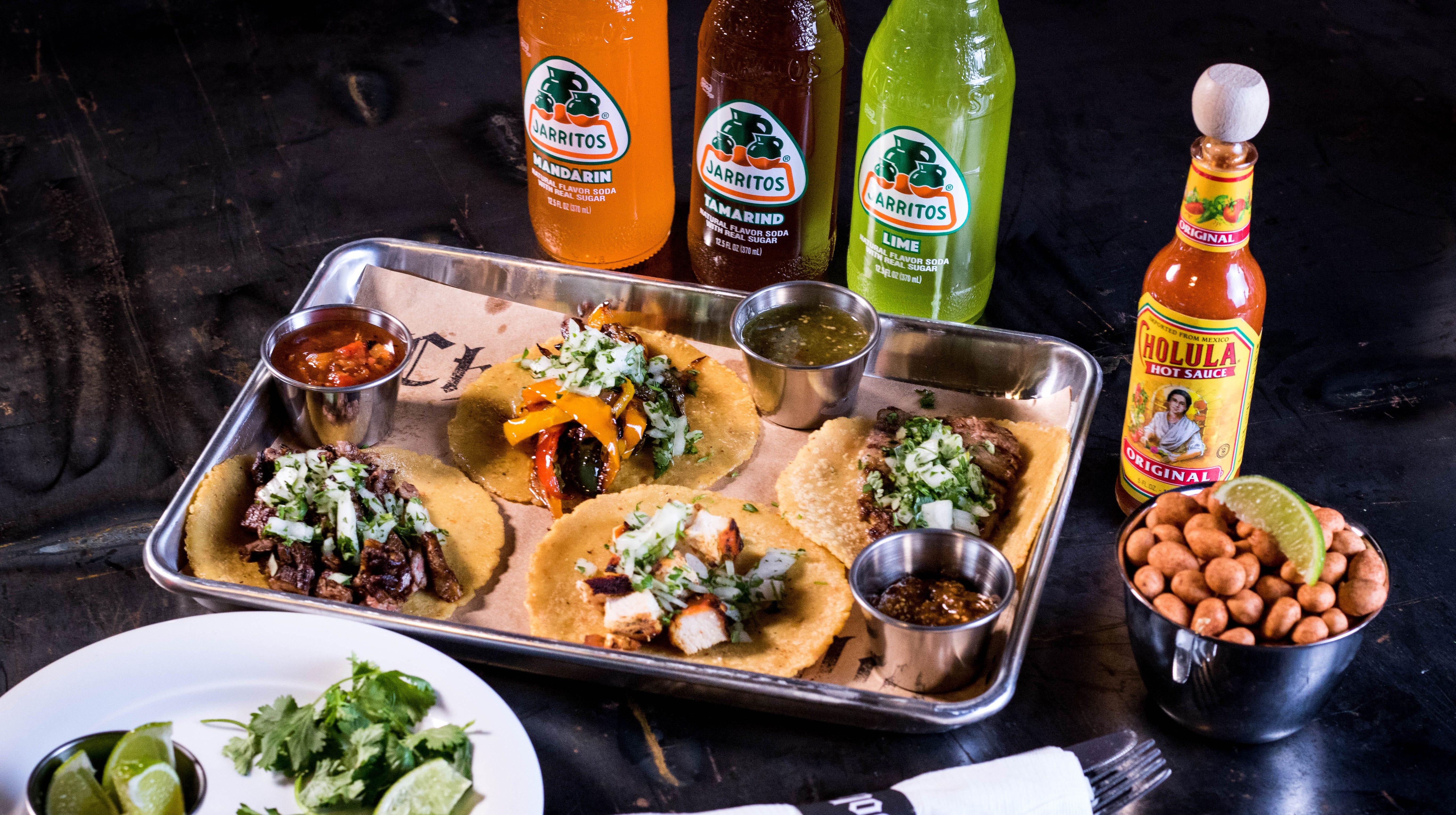 Assorted tacos on housemade, fresh masa tortillas...