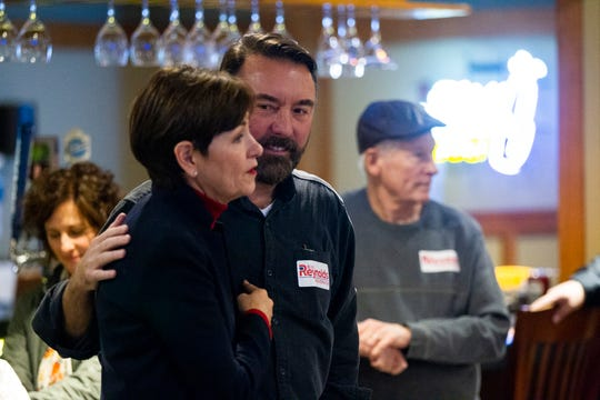 Iowa Gov. Kim Reynolds introduces Christopher Peters on Sunday, Nov. 4, 2018, at Brown Deer Golf Club in Coralville, Iowa.
