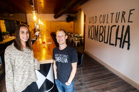 Wild Culture Kombucha co-owners Rachelle Schmidt and Tim Roed pose for a photo on Wednesday, Oct. 31, 2018, inside their store in Iowa City.