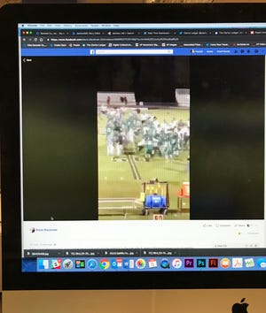 This photo of a Facebook post shows a fight following a high school football game.