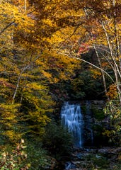 Fall foliage surrounds Meigs Falls in the Great Smoky Mountains National Park on Sunday, November 4, 2018.