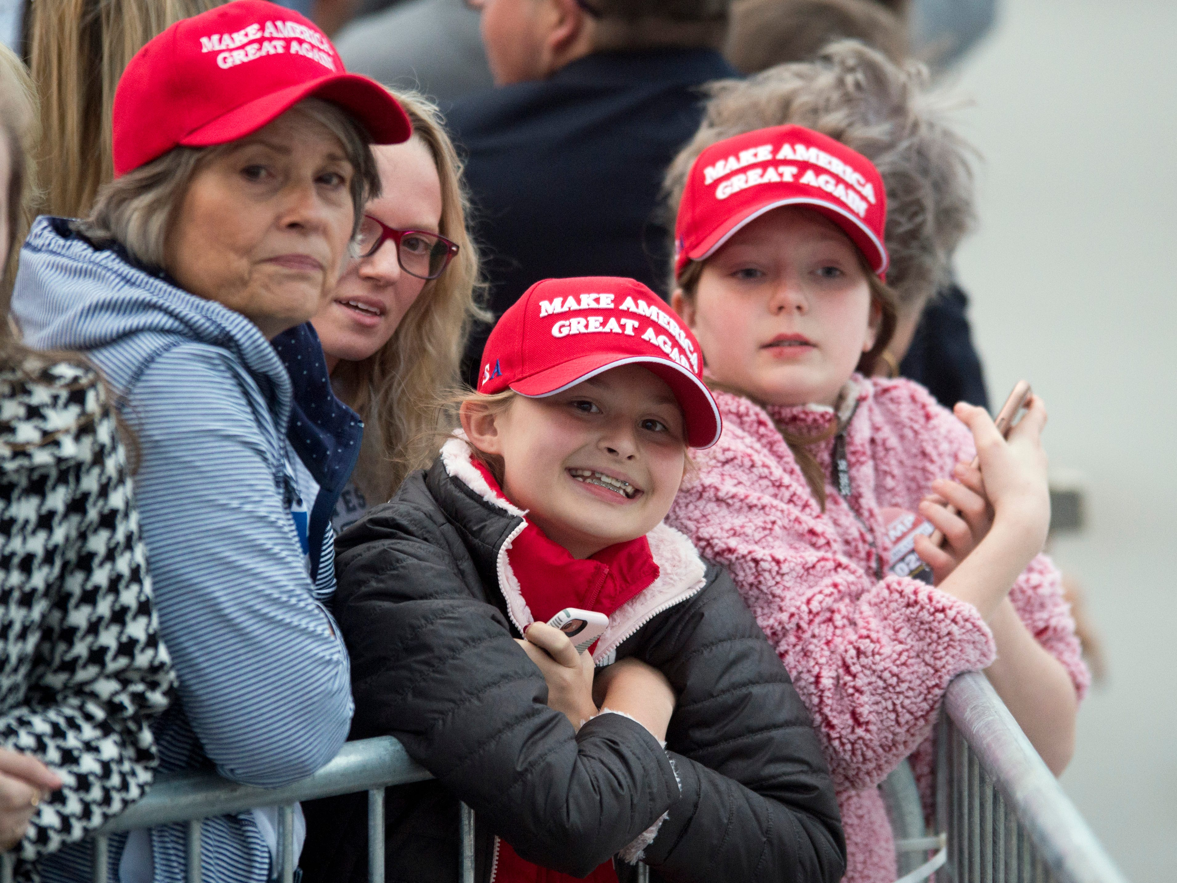 A group of guests wait for the arrival of President Donald Trump to Chattanooga Metropolitan Airport on Sunday, November 4, 2018.