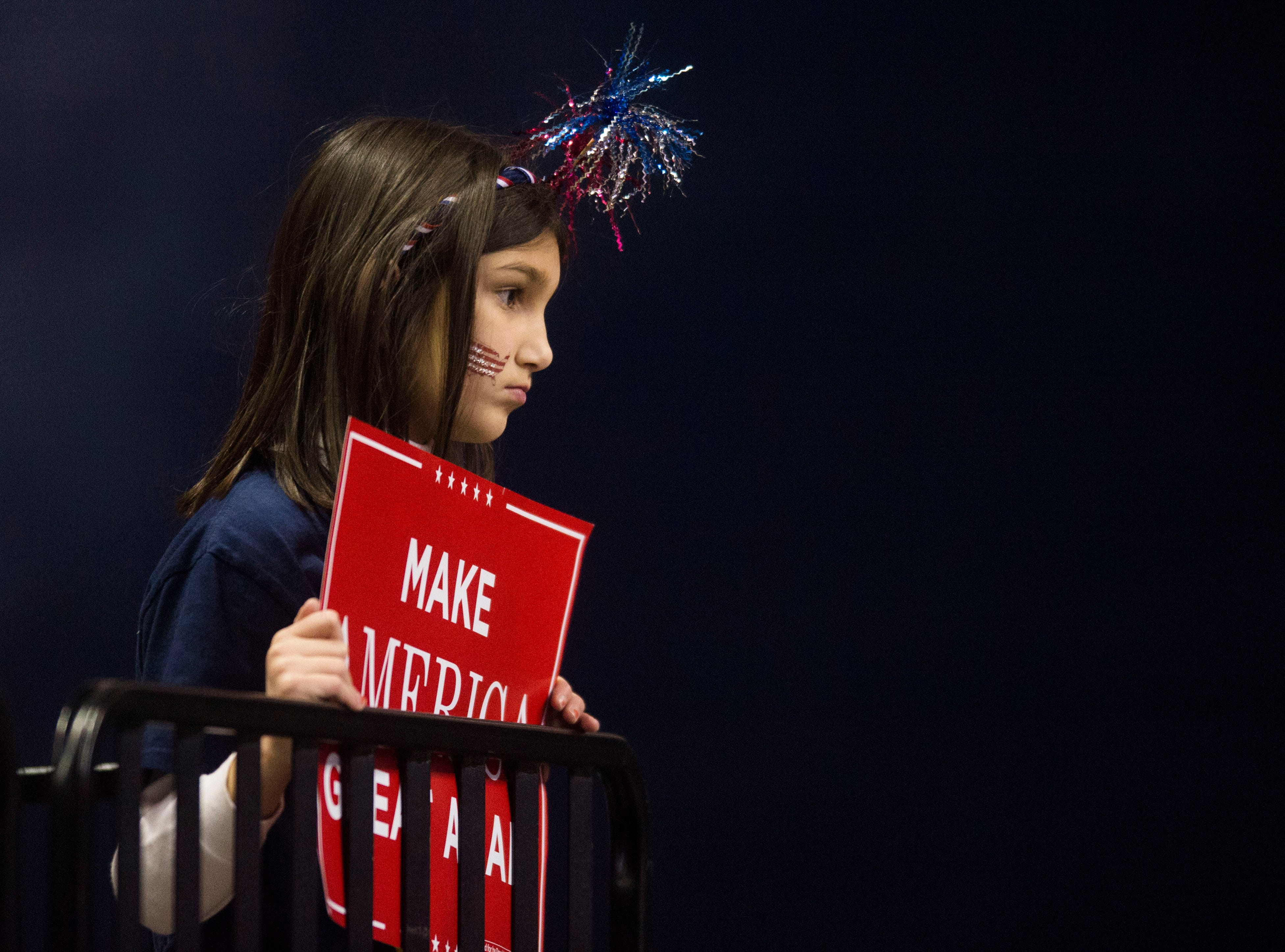 A young Trump supporter watches during a Donald Trump rally in support of U.S. Rep. Marsha Blackburn for the U.S. Senate at McKenzie Arena in Chattanooga, Sunday, Nov. 4, 2018.