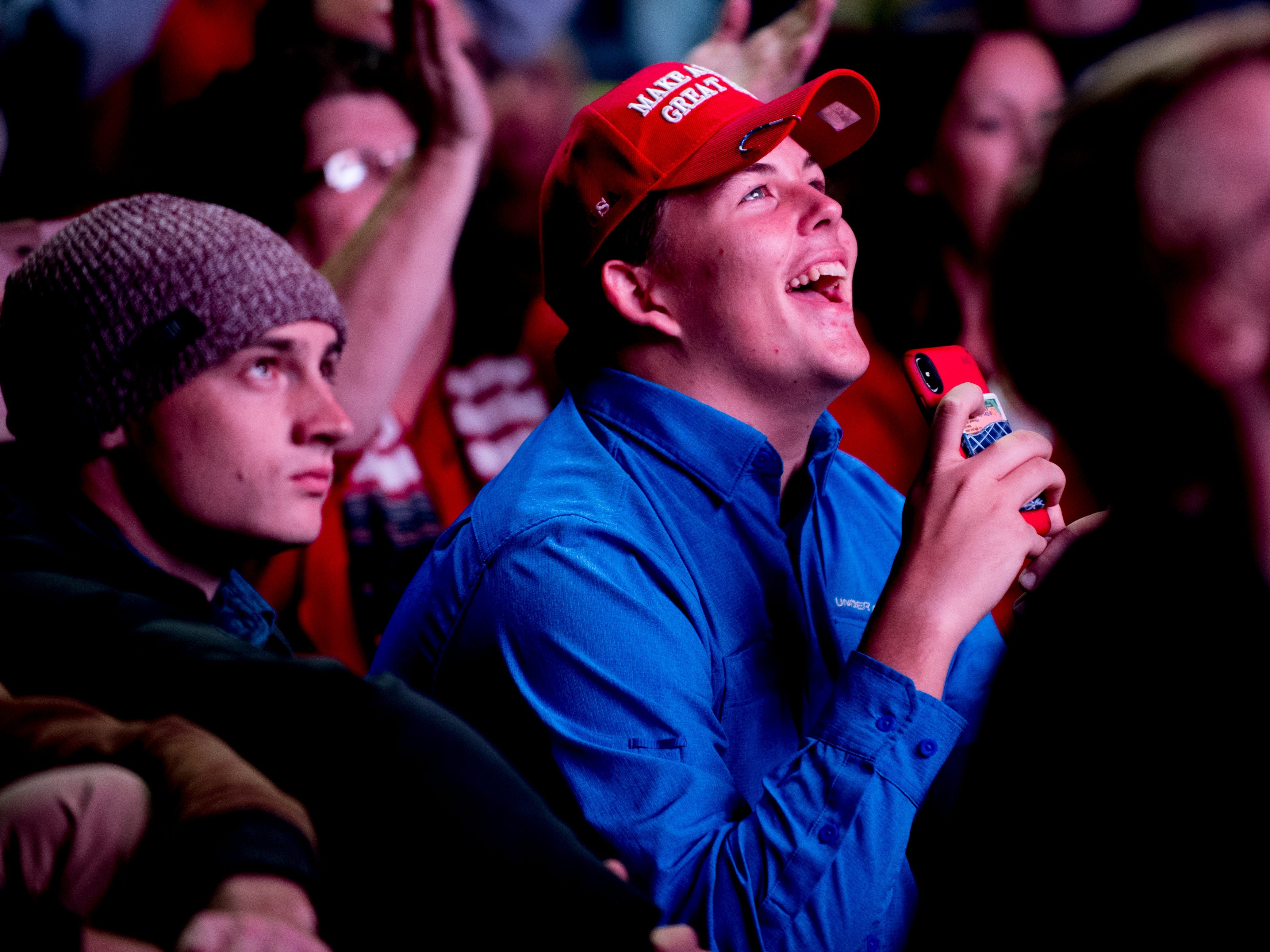 """A supporter laughs during President Donald J. Trump's """"Make America Great Again"""" Rally public showing outside of McKenzie Arena in Chattanooga, Tennessee on Sunday, November 4, 2018."""
