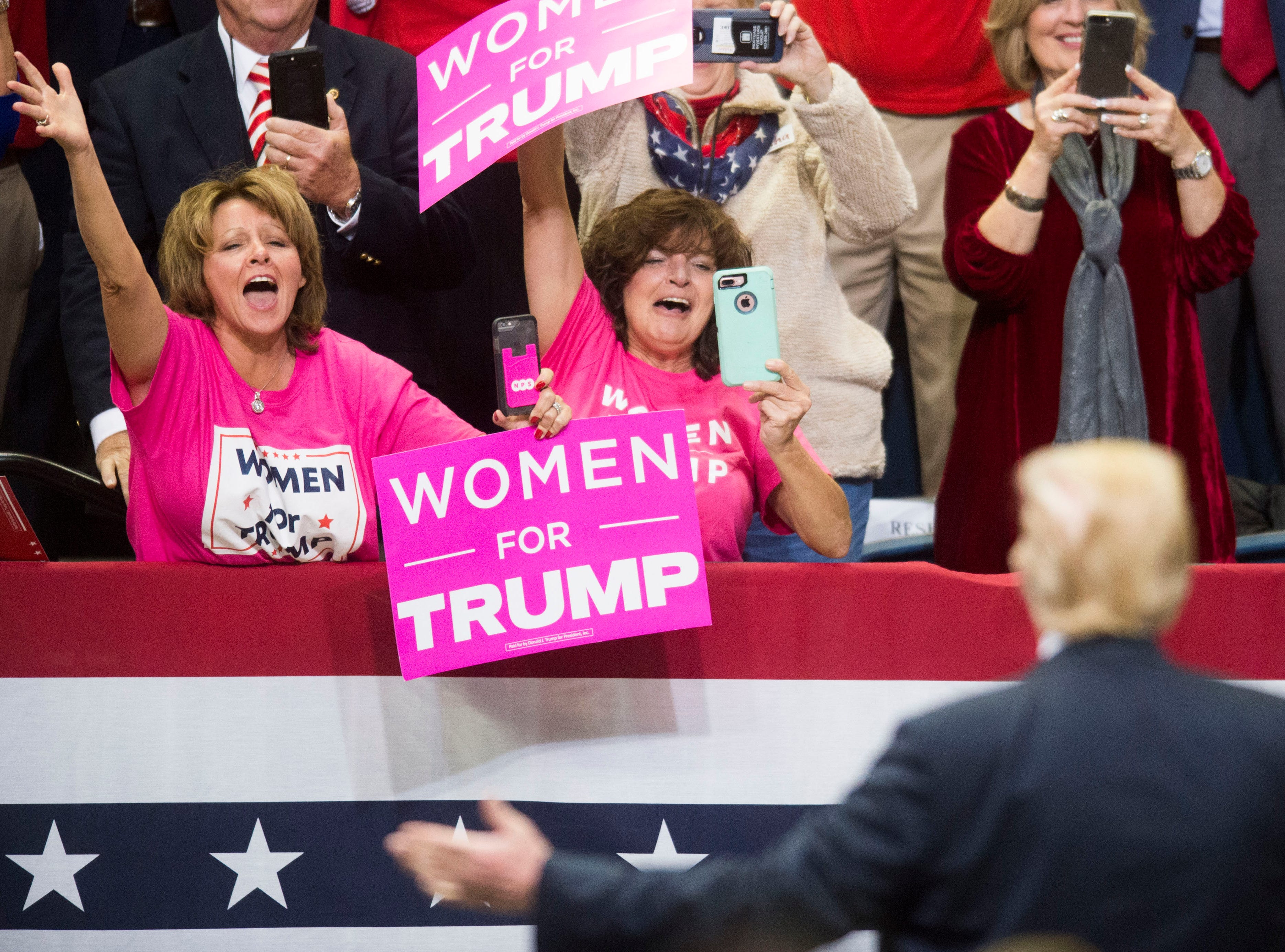 Trump supporters cheer for him during a Donald Trump rally in support of U.S. Rep. Marsha Blackburn for the U.S. Senate at McKenzie Arena in Chattanooga, Sunday, Nov. 4, 2018.