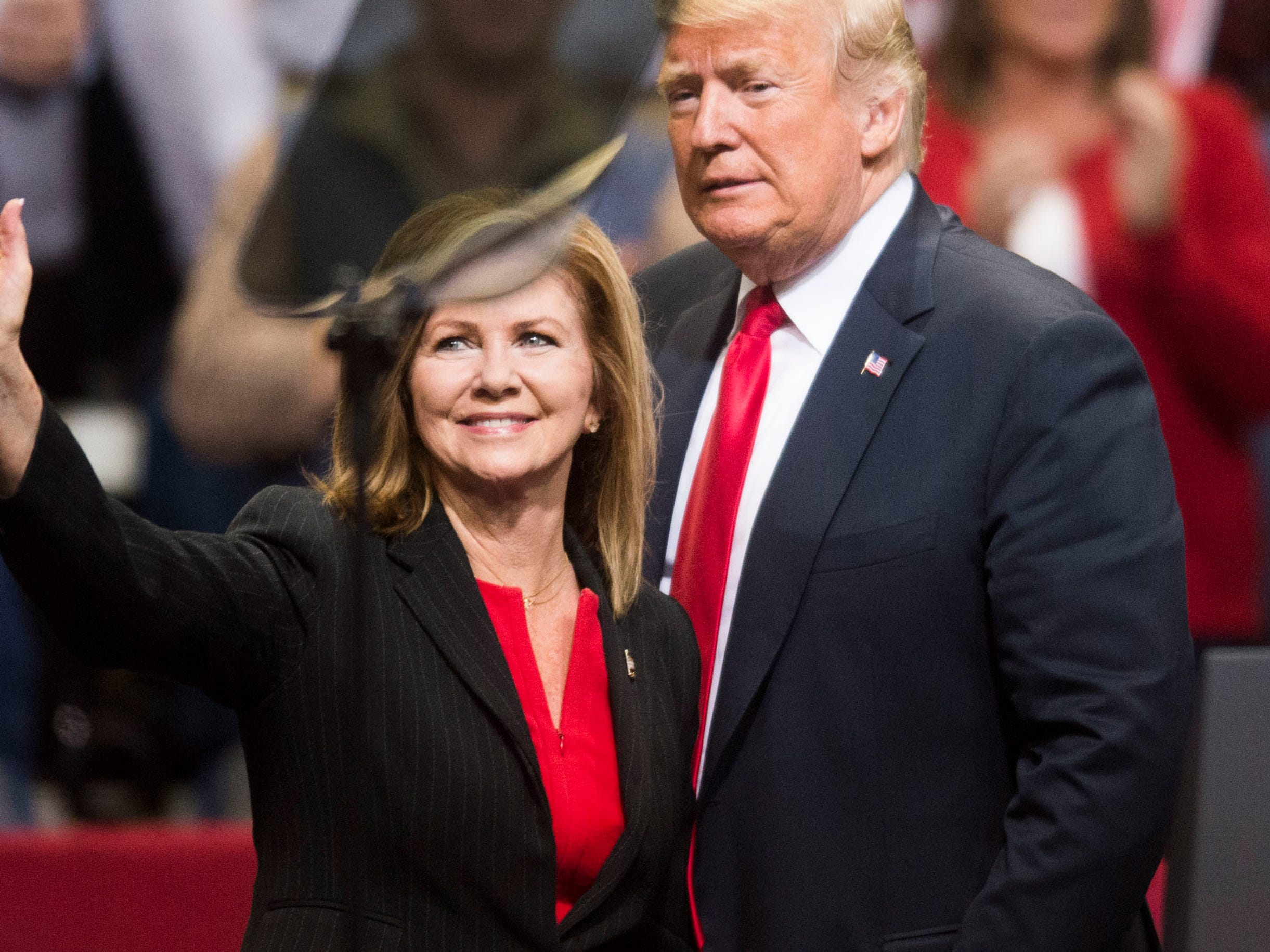 President Donald Trump greets U.S. Rep. Marsha Blackburn during a Donald Trump rally in support of U.S. Rep. Marsha Blackburn for the U.S. Senate at McKenzie Arena in Chattanooga, Sunday, Nov. 4, 2018.