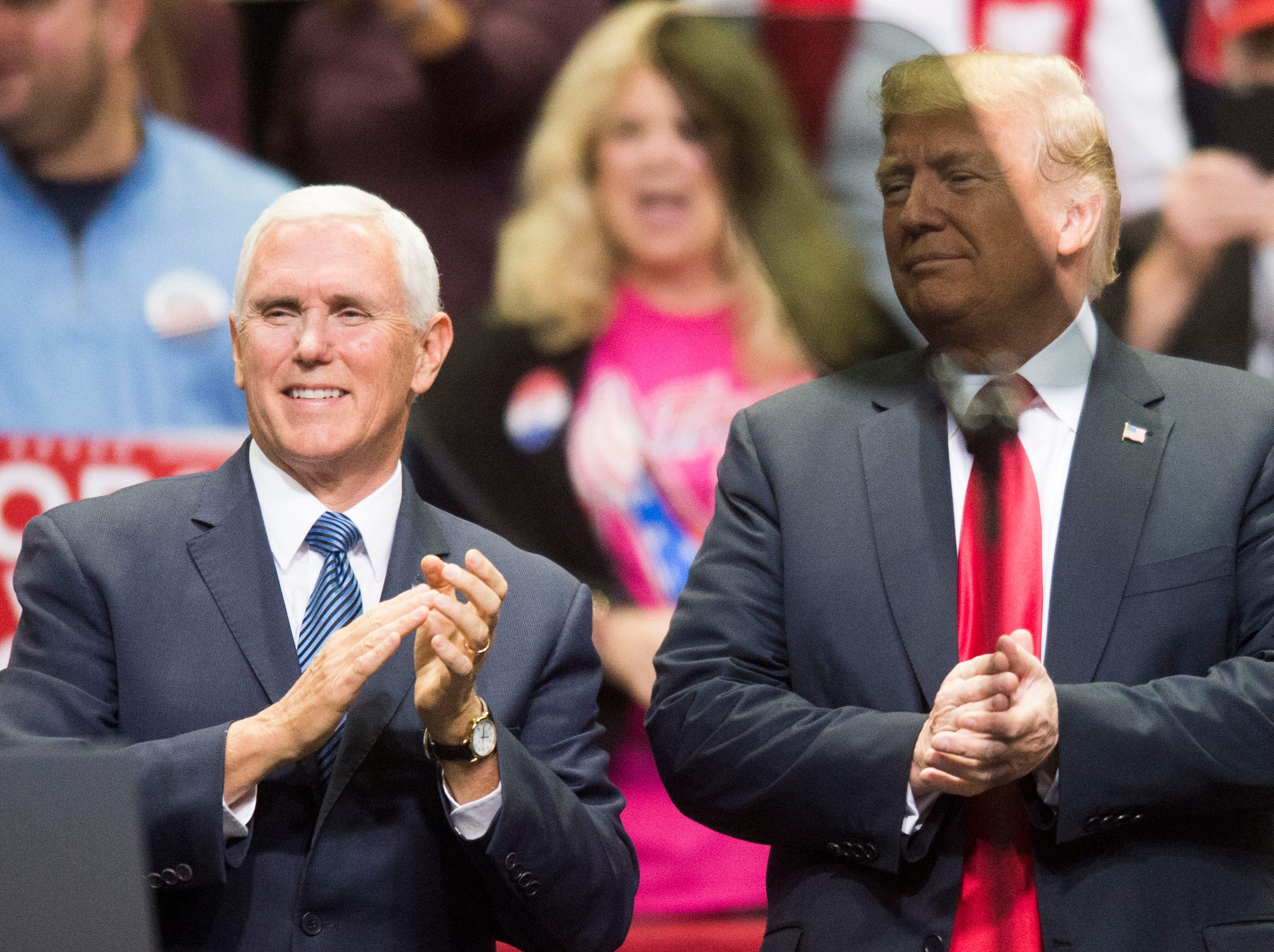 Vice President Mike Pence and President Donald Trump stand on stage during a Donald Trump rally in support of U.S. Rep. Marsha Blackburn for the U.S. Senate at McKenzie Arena in Chattanooga, Sunday, Nov. 4, 2018.