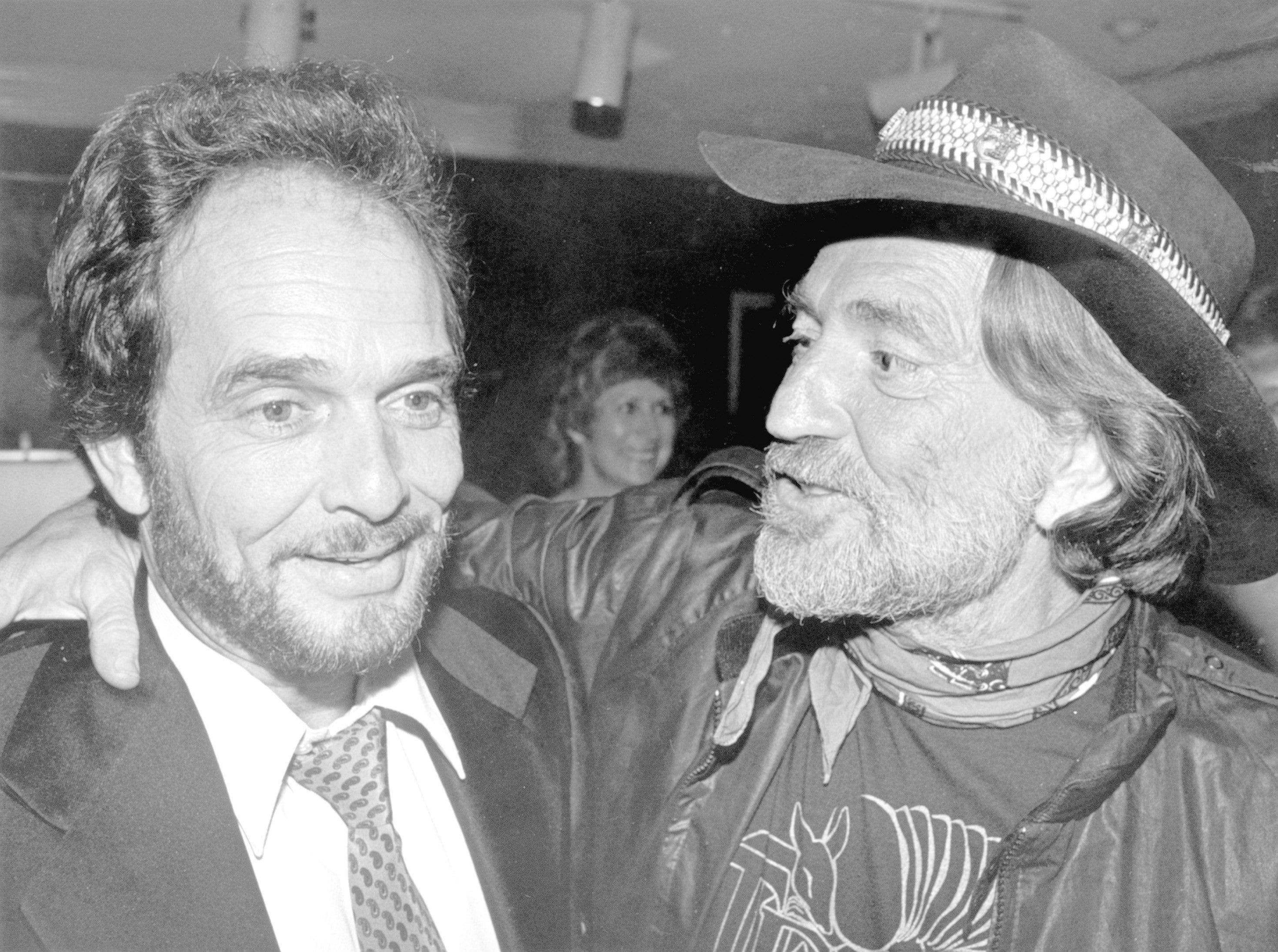Merle Haggard, left, and Willie Nelson attend the BMI awards dinner in Nashville in October 1981.