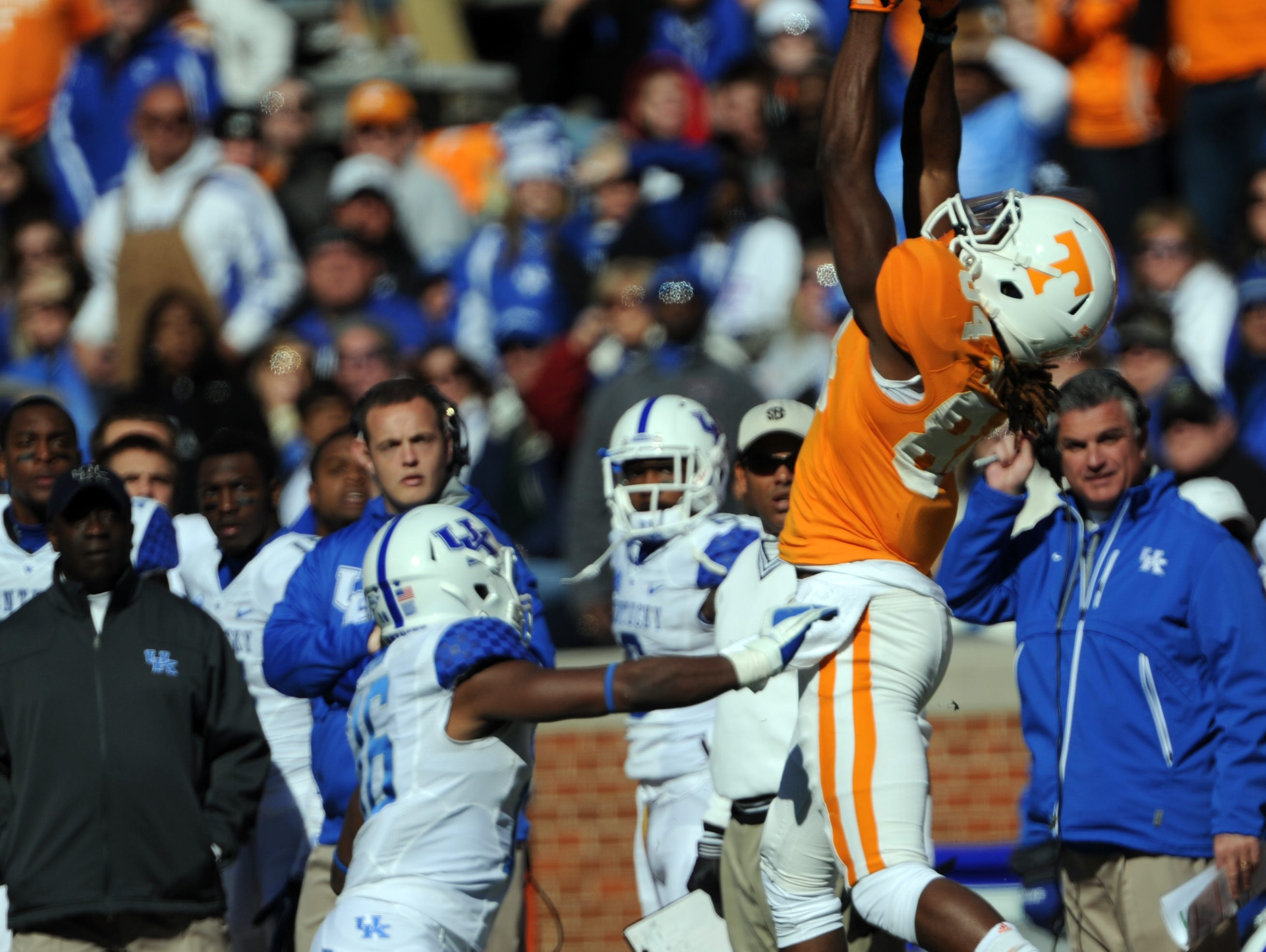 Tennessee wide receiver Cordarrelle Patterson (84) makes a catch for a first down in the first quarter as Kentucky defensive back Cody Quinn (16) defends at Neyland Stadium Saturday, Nov. 24, 2012. Six days after head coach Dereck Dooley was fired, the Vols closed the season with a 37-17 win under interim coach Jim Chaney.