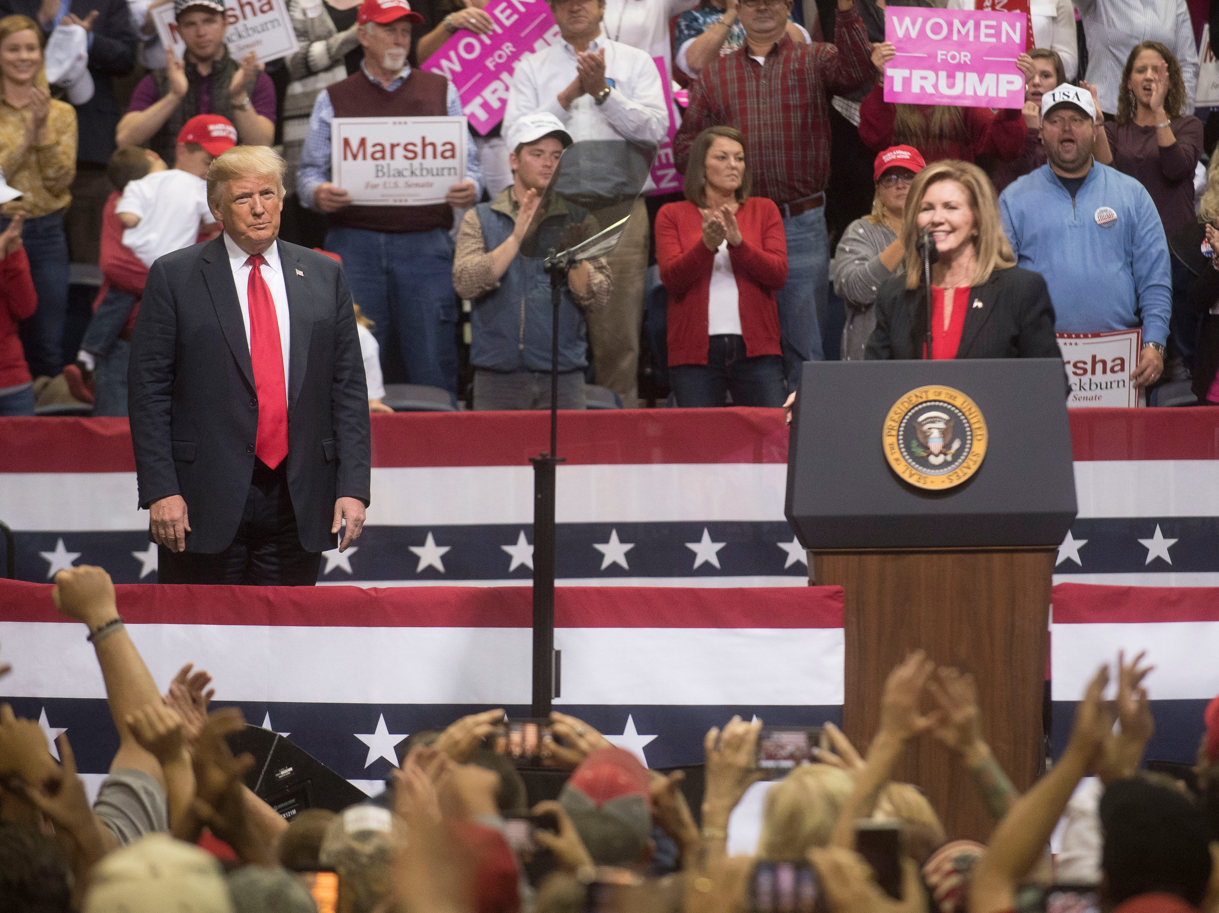 President Trump stands on stage with U.S. Rep. Marsha Blackburn at a rally in support of her for the U.S. Senate at McKenzie Arena in Chattanooga, Sunday, Nov. 4, 2018.