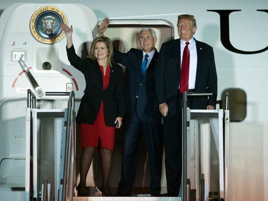 President Donald Trump, Vice President Mike Pence, and Rep. Marsha Blackburn greet the crowd as they descend from Air Force One at the Chattanooga Metropolitan Airport on Sunday.