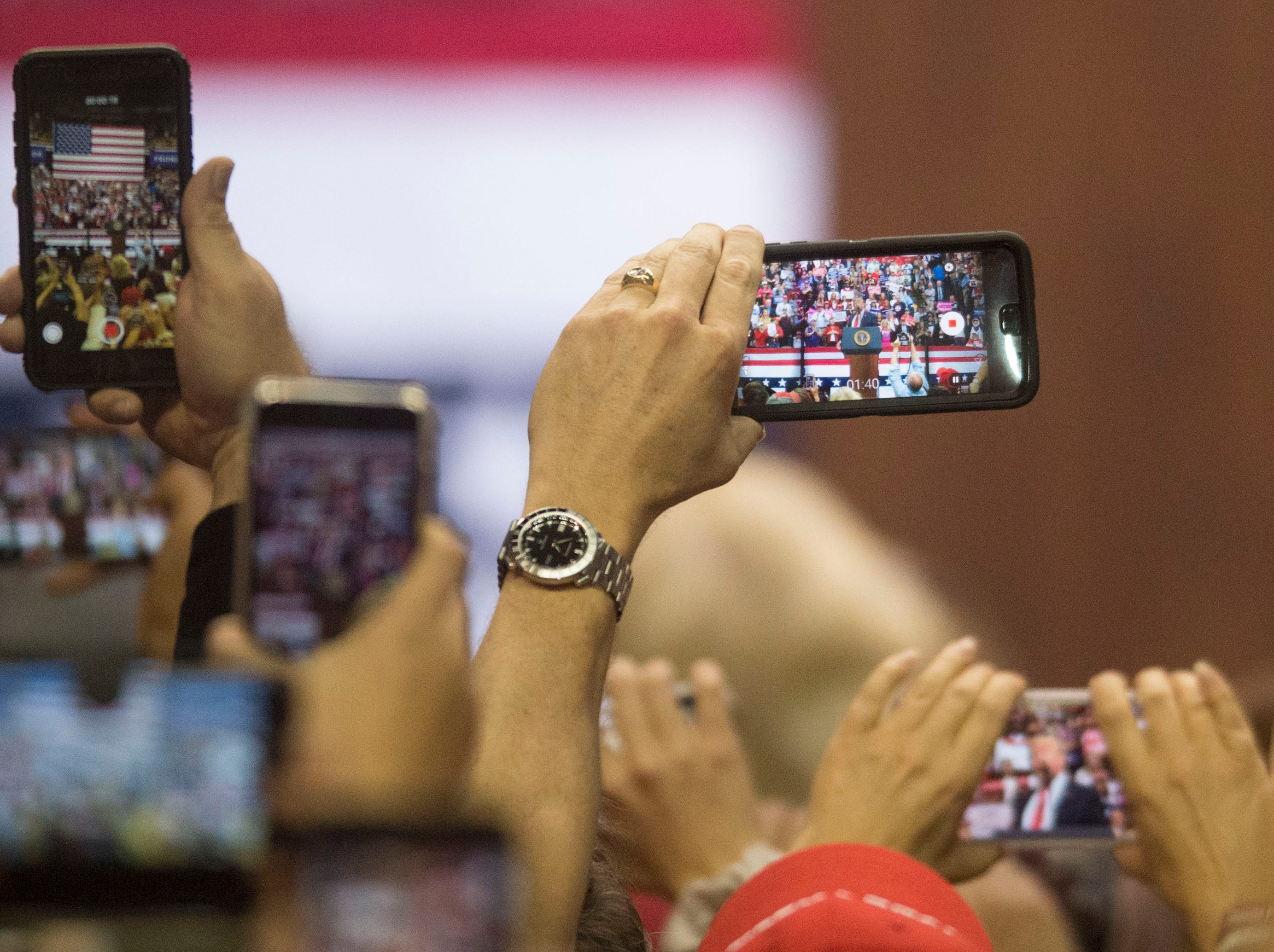 Trump supporters capture him on their phones during a Donald Trump rally in support of U.S. Rep. Marsha Blackburn for the U.S. Senate at McKenzie Arena in Chattanooga, Sunday, Nov. 4, 2018.
