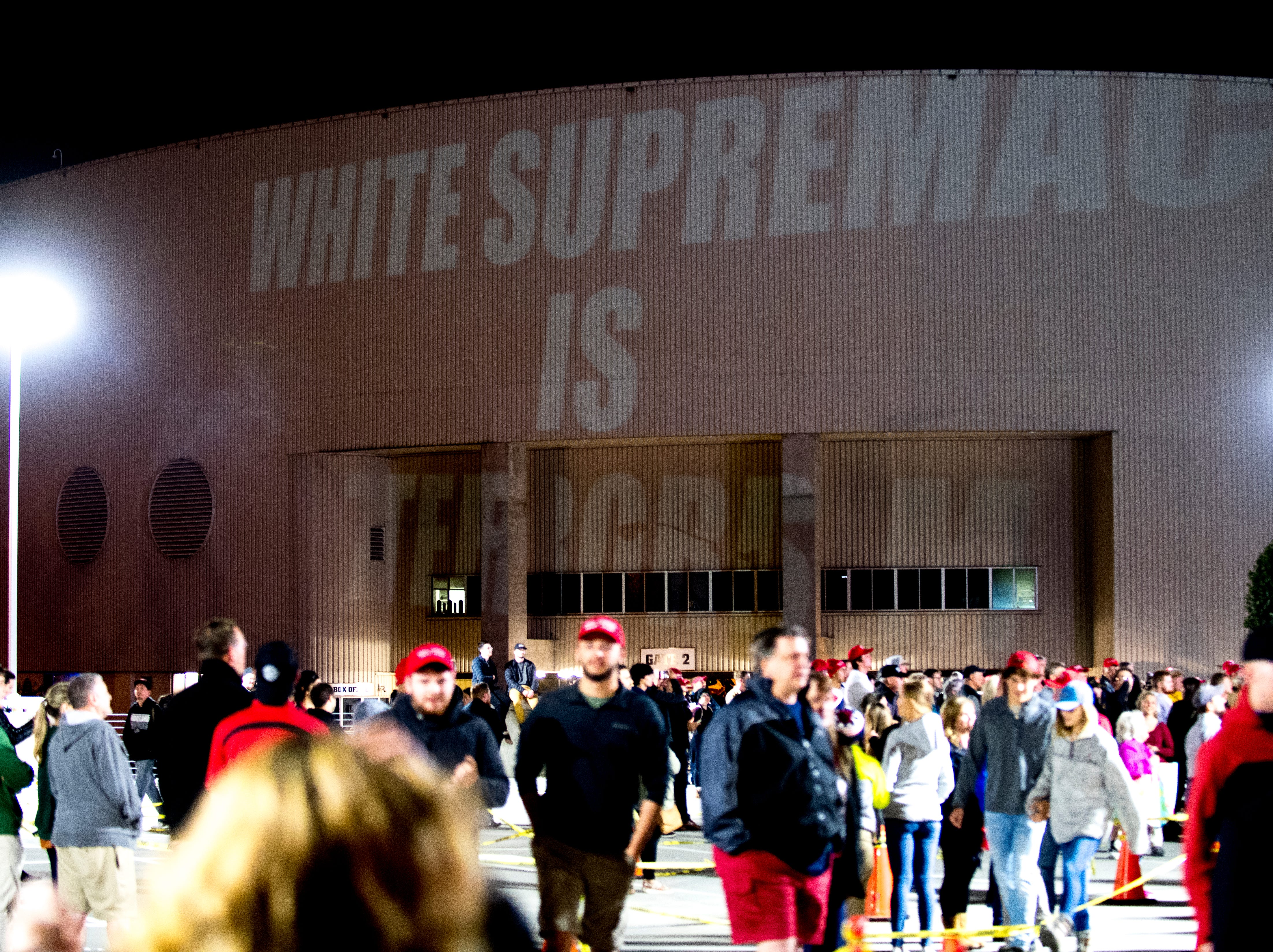 """""""White Supremacy is Terrorism"""" is projected onto the arena during President Donald J. Trump's """"Make America Great Again"""" Rally at McKenzie Arena in Chattanooga, Tennessee on Sunday, November 4, 2018."""