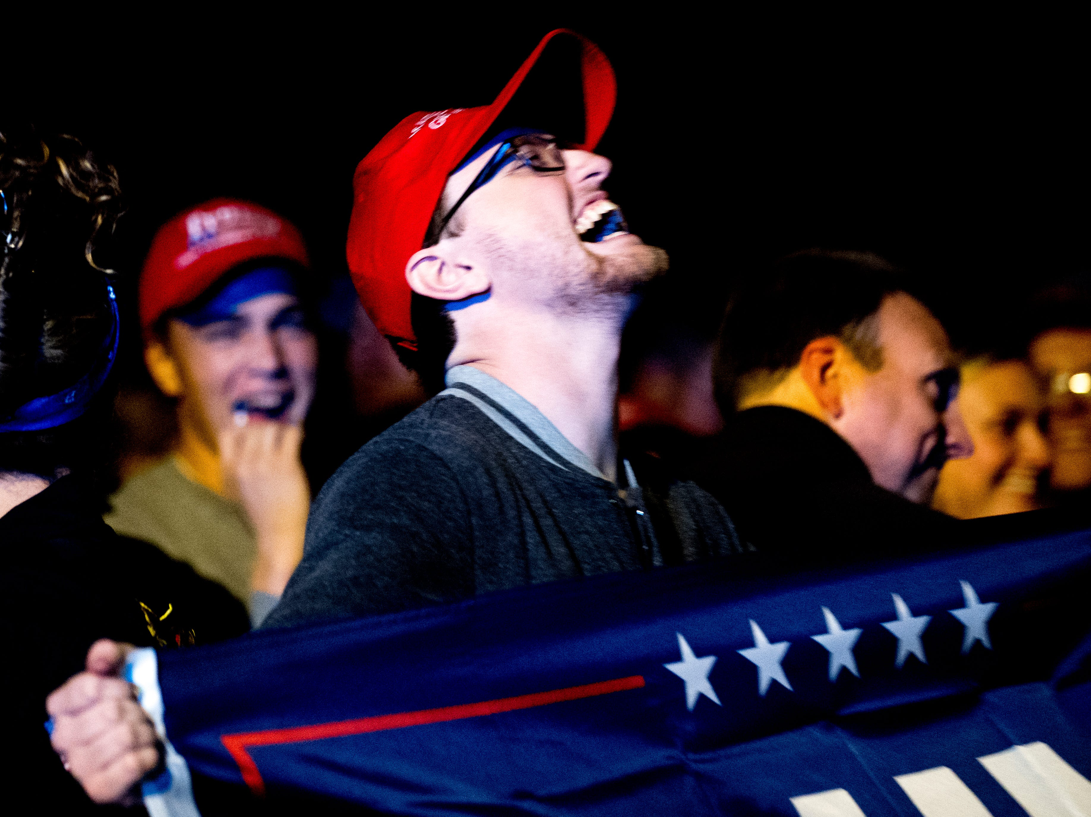 """A Trump supporter banters with protestors during President Donald J. Trump's """"Make America Great Again"""" Rally at McKenzie Arena in Chattanooga, Tennessee on Sunday, November 4, 2018."""