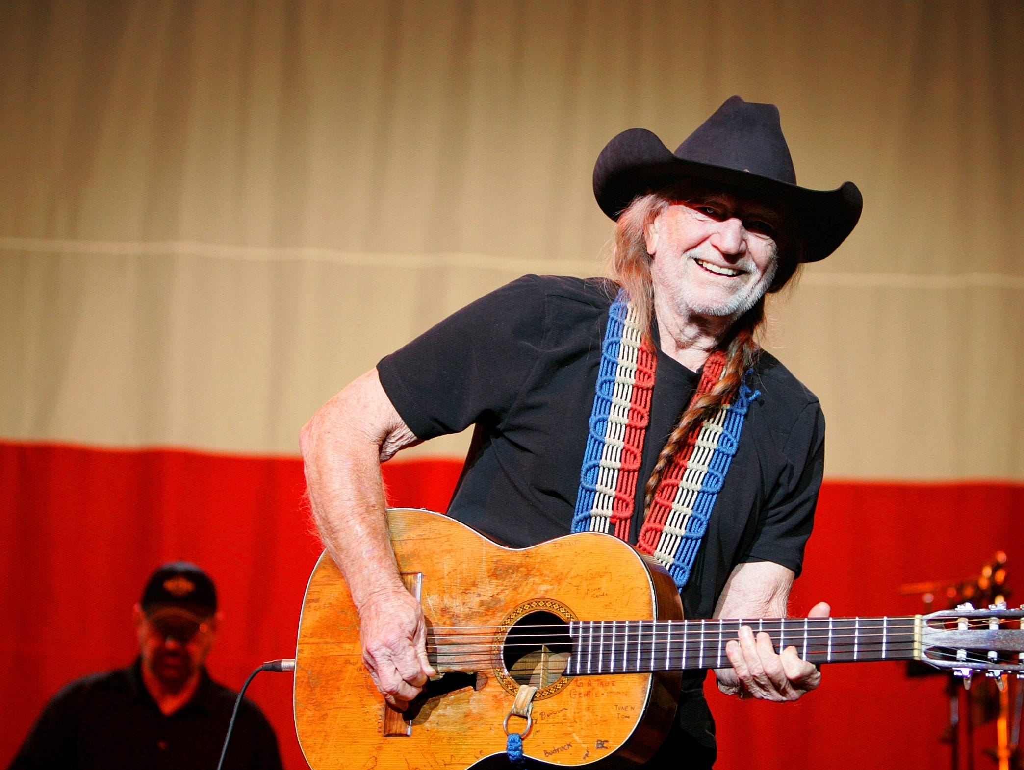 Willie Nelson performs in Dubuque, Iowa, Thursday, Dec. 4, 2008, while on tour with Billy Bob Thornton.