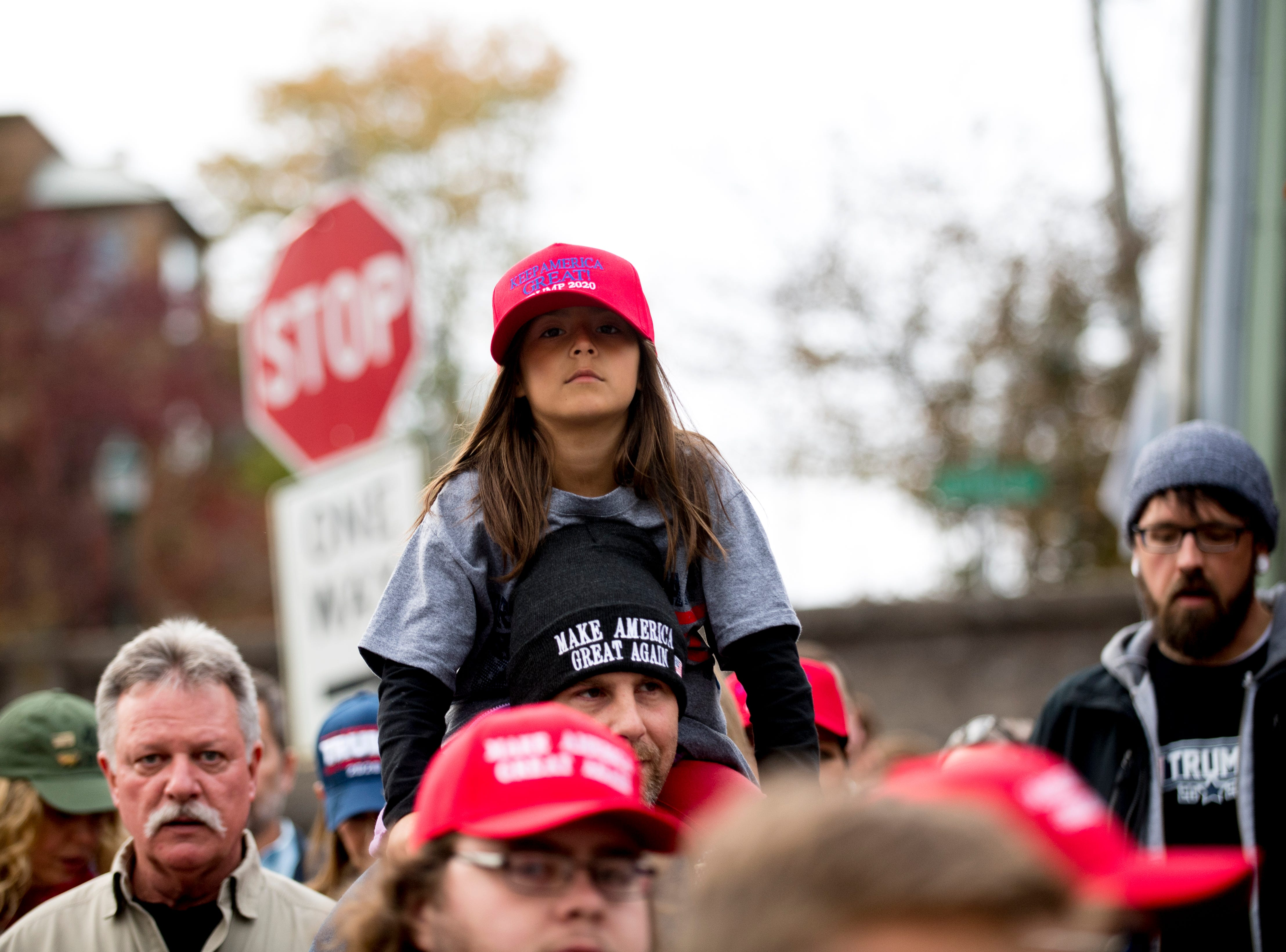 """A young Trump supporter gets a better view of her surroundings ahead of President Donald J. Trump's """"Make America Great Again"""" Rally at McKenzie Arena in Chattanooga, Tennessee on Sunday, November 4, 2018."""