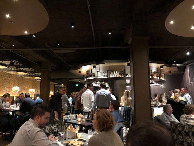 My husband and I visited Kefi their first Friday night in business. The bar was packed during our visit, so we opted for a table.