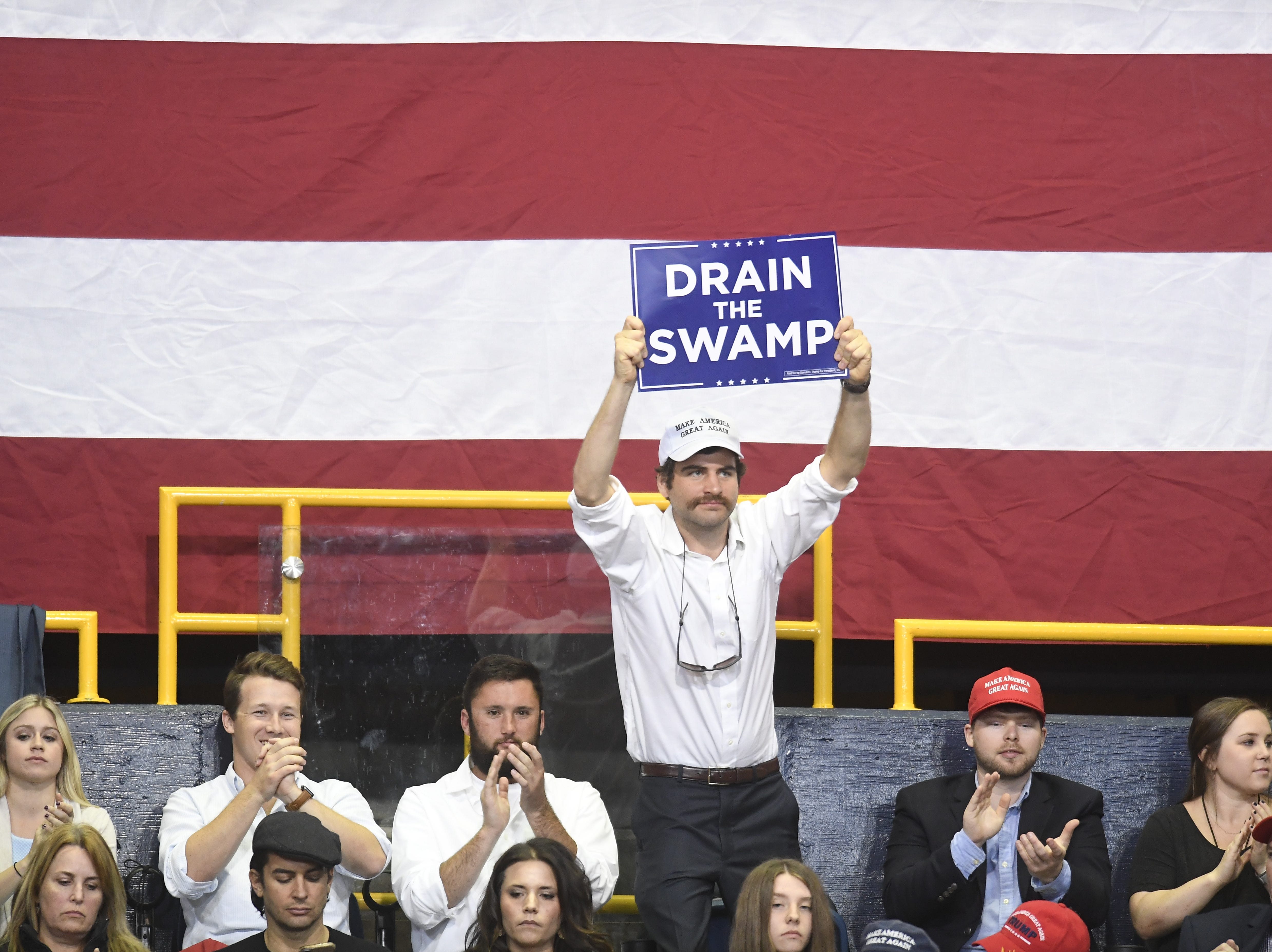 A supporter stands above the others during President Donald Trump's Make America Great Again Rally for Marsha Blackburn on Sunday, Nov. 4, 2018 in Chattanooga.