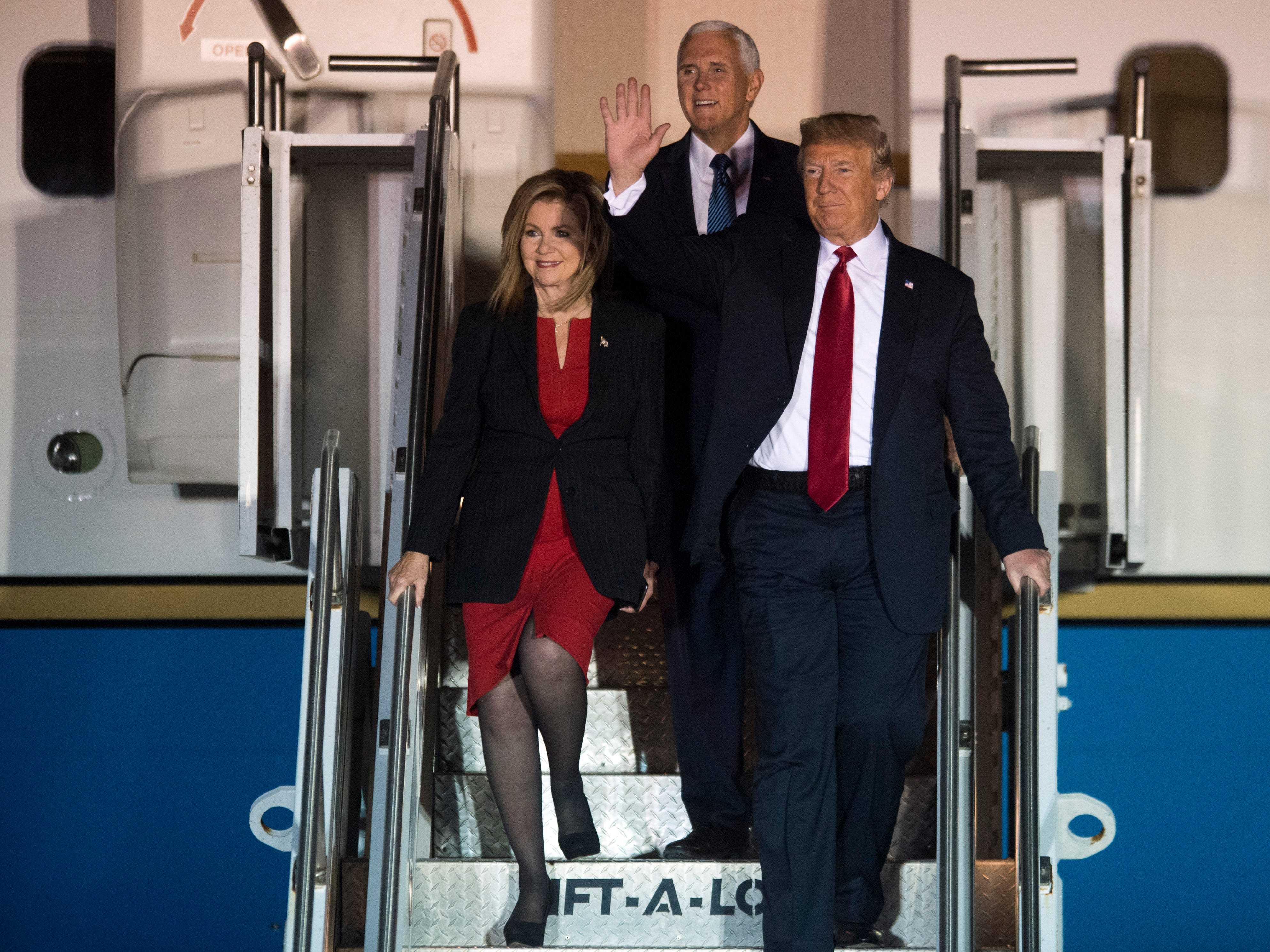 President Donald Trump, Vice President Mike Pence, and Rep. Marsha Blackburn greet the crowd as they descend from Air Force One at Wilson Air Center at the Chattanooga Metropolitan Airport on Sunday, November 4, 2018.