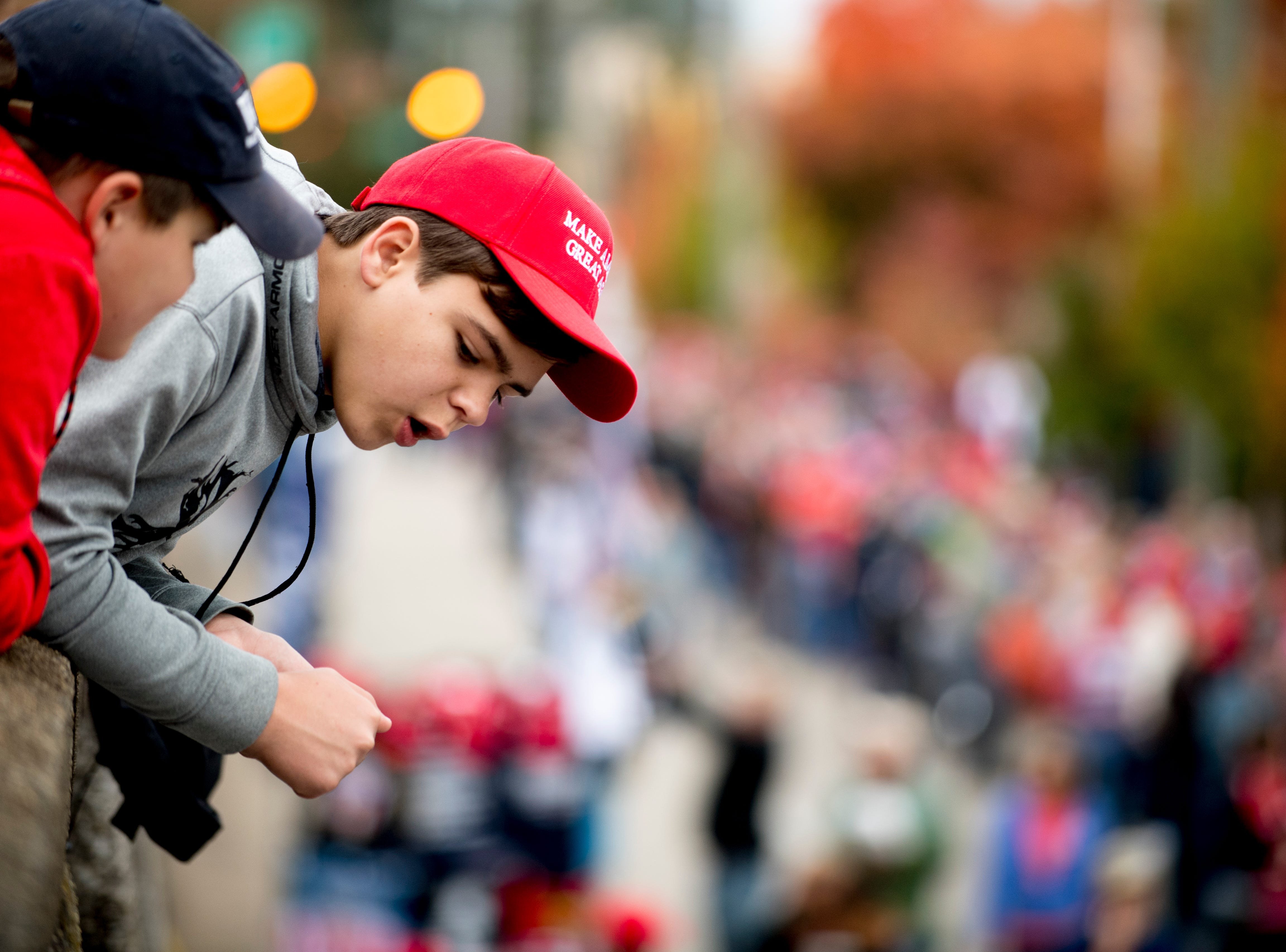 """Zeth Dishman, 13, and Jack Simmons, 11, both from Chattanooga, lean over a ledge for a better view ahead of President Donald J. Trump's """"Make America Great Again"""" Rally at McKenzie Arena in Chattanooga, Tennessee on Sunday, November 4, 2018."""