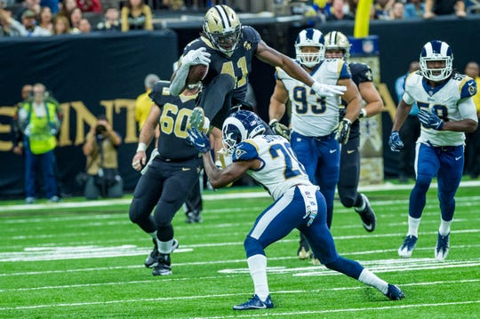 Saints runningback Alvin Kamara leaps over defender during the NFL football game between the New Orleans Saints and the Los Angeles Rams on Sunday, Nov. 4, 2018.
