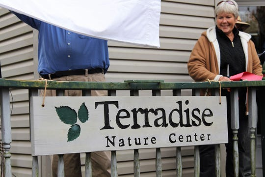 David Hademan unveils a sign Saturday as his childhood home near Caledonia becomes the Terradise Nature Center.