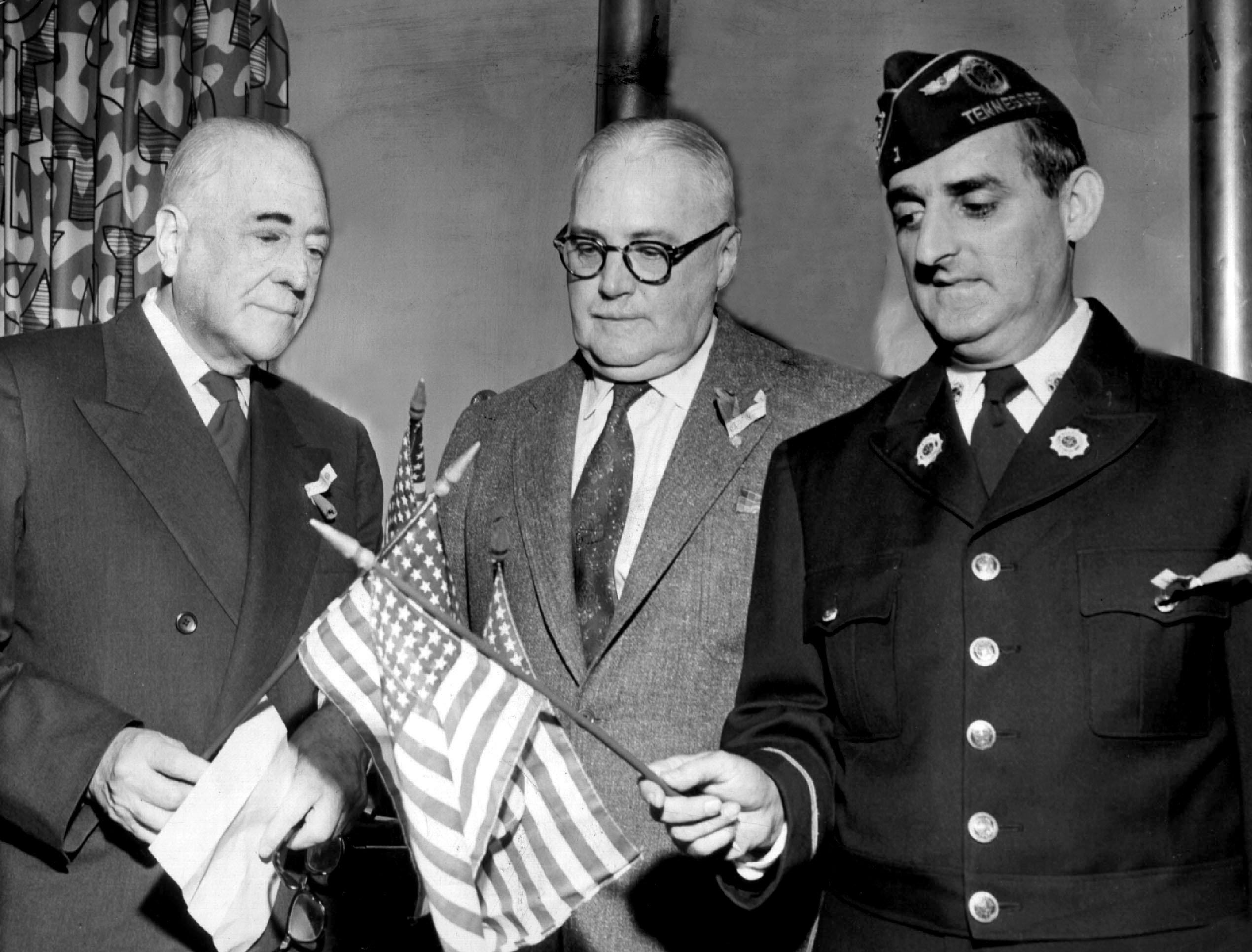 Jack Carley (center), a member of The Commercial Appeal's editorial staff for 39 years, is seen in a photograph dated November 12, 1955. At left is W. Percy McDonald Sr and Sam Friedman is at right. Carley was born near Ottawa, Ontario, Canada, and served in the British Army in World War I. He was a newspaperman in Los Angeles and Chicago before coming to Memphis in 1923. He joined The Commercial Appeal's staff as a reporter and was promoted to the positions of city editor, managing editor and editorial writer. Carley's editorials won him many honors, and he was best known for his writings on law enforcement, Mississippi River flood control and military preparedness. At the request of his close friend, FBI Director J. Edgar Hoover, Carley spoke many times to graduating classes of the National Academy of the Federal Bureau of Investigation. Carley was a longtime member of the Memphis and Shelby County Port Commission; and in 1962, shortly after his death, the commission adopted a resolution to honor Carley by naming the causeway for him.