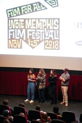 Filmmaker Bridey Elliott and her family talk after the screening of Clara's Ghost