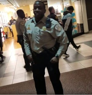 A Shelby County Sheriff's Office deputy is seen warning journalist Kevin McKenzie he is in violation of mall policy for using his cell phone to record another person being detained.