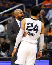 Memphis Grizzlies head coach J.B. Bickerstaff talks to Dillon Brooks (24) in the second half during an NBA basketball game against the Phoenix Suns, Sunday, Nov. 4, 2018, in Phoenix. The Suns defeated the Grizzlies 102-100.