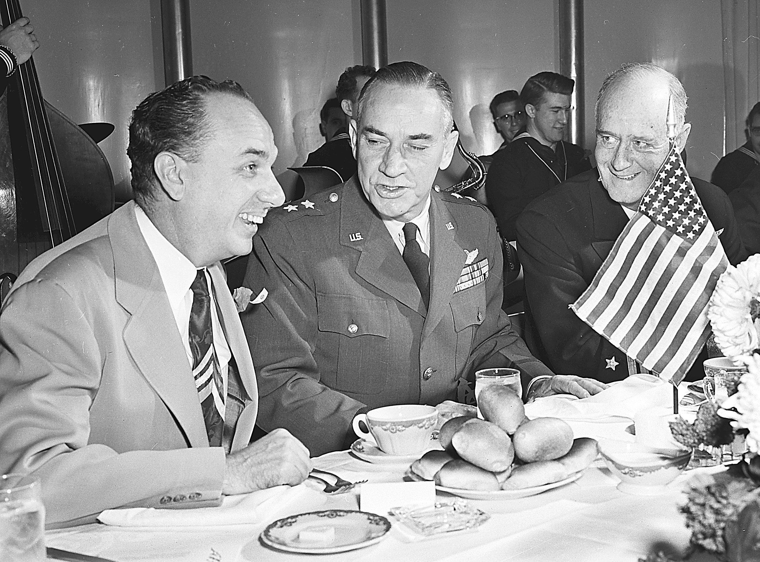 Top-ranking visitors attending the Victory Day luncheon at The Peabody on 11 Nov 1952 were Vice Adm. Felix B. Stump (Right), commander of the Second Fleet and luncheon speaker, and Maj. Gen. Robert W. Douglass Jr. (Center), commander of the 18th Air Force, who were greeted by Judge Carl Stokes, chairman of the American Legion's luncheon committee.
