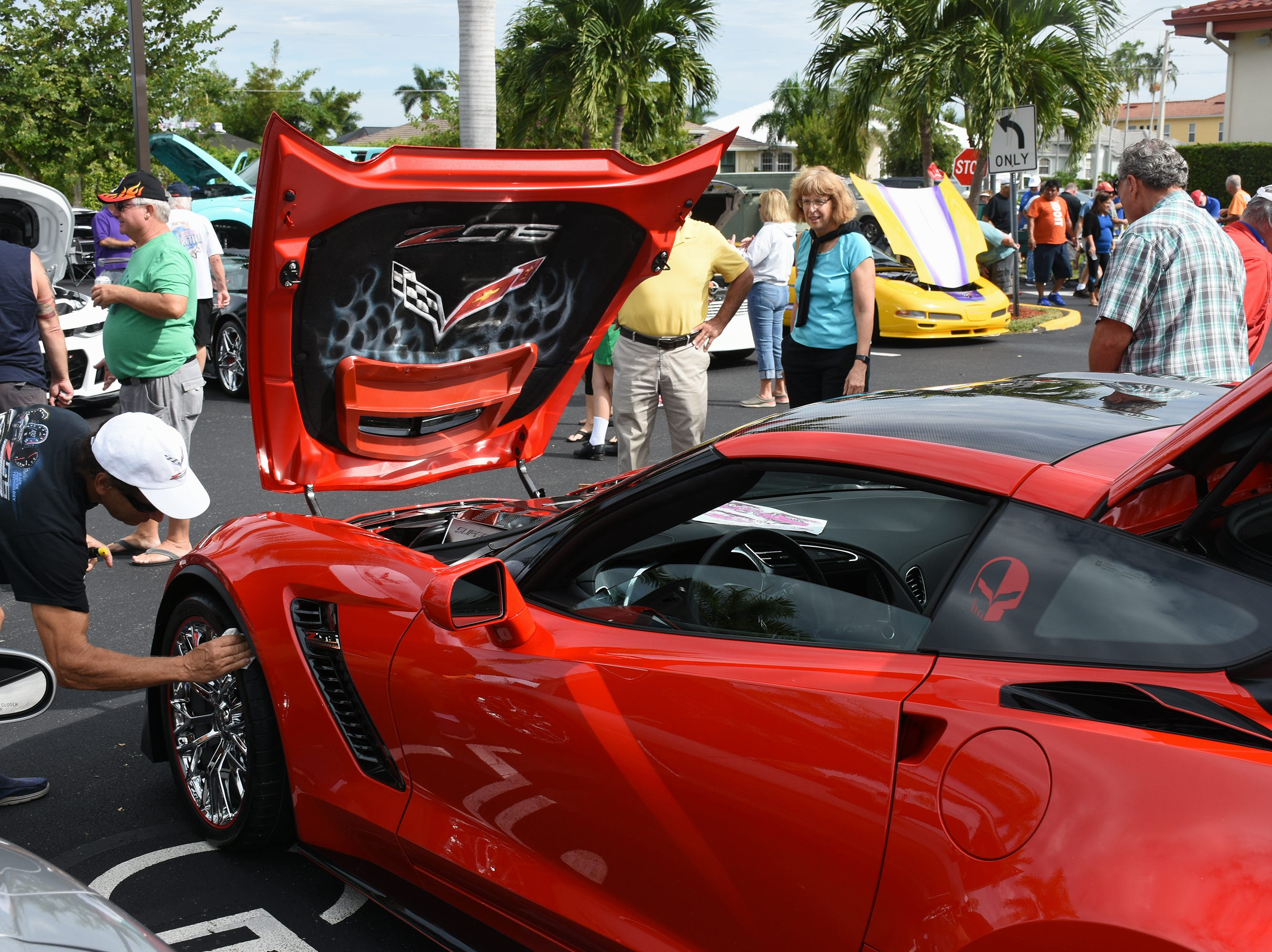 Tony Costantino of the Corvette Club finds a speck of dust on his 2016 Z 06. The Marco Island Knights of Columbus held their inaugural car show Saturday in the parking lot at San Marco Catholic Church.
