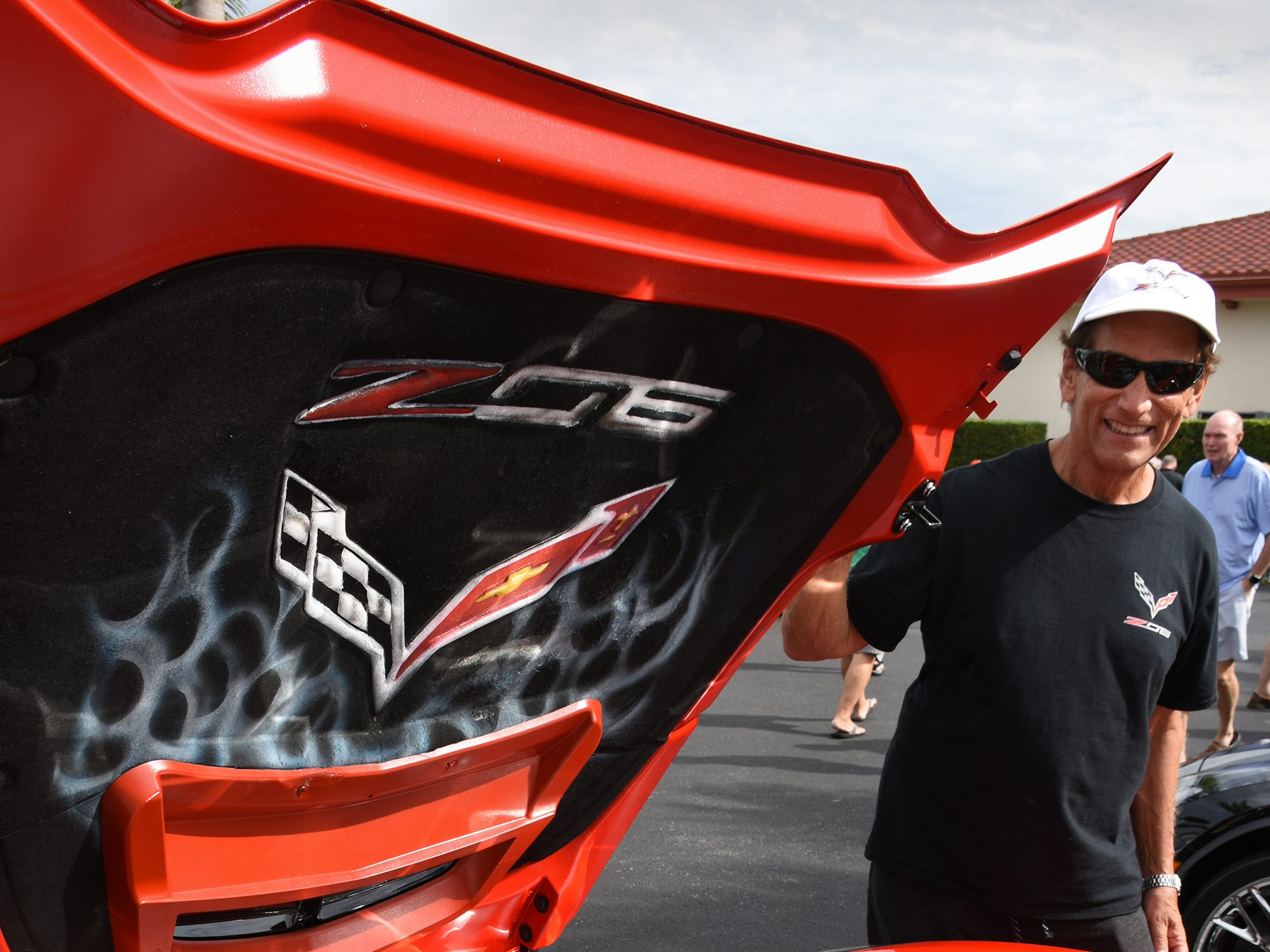 Tony Costantino of the Corvette Club shows off his 2016 Z 06. The Marco Island Knights of Columbus held their inaugural car show Saturday in the parking lot at San Marco Catholic Church.
