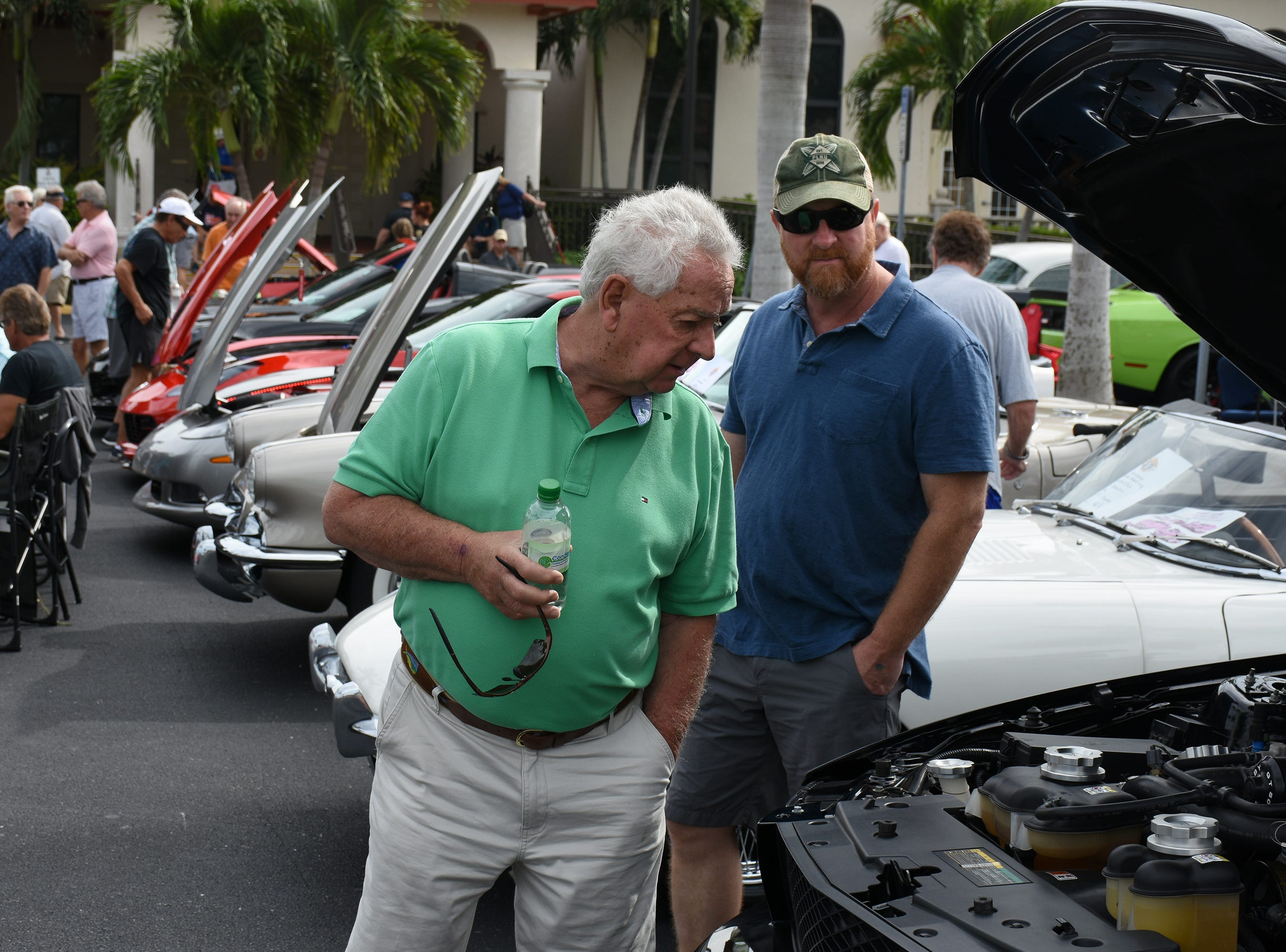Bill Roy and Don Roy look under the hood. The Marco Island Knights of Columbus held their inaugural car show Saturday in the parking lot at San Marco Catholic Church.