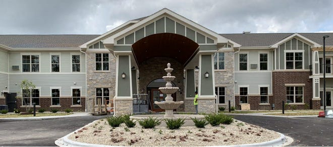 The opening of the Heritage Senior Living apartments in Muskego is being delayed after building inspectors found the developer reduced the amount of masonry in the facades without approval.