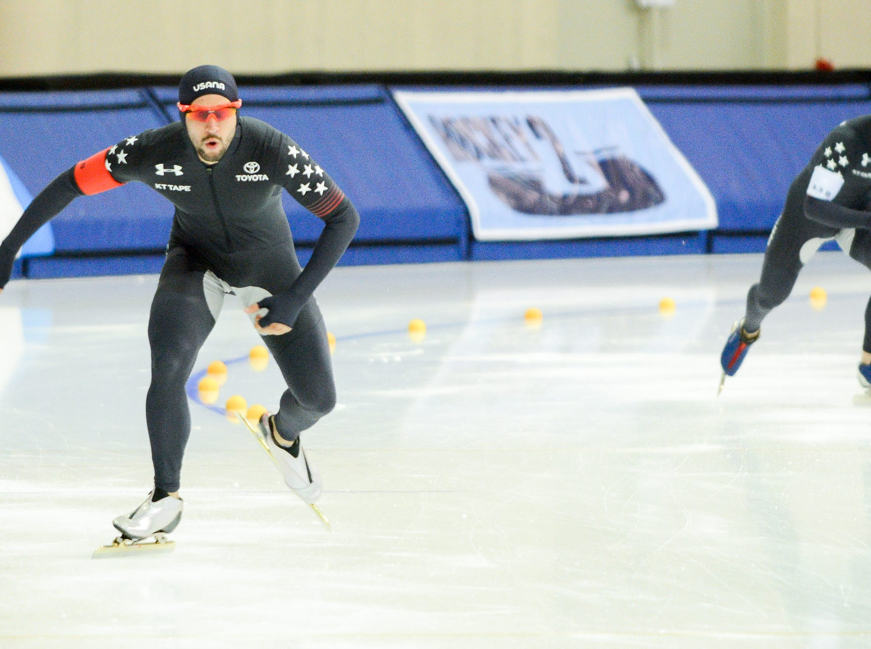 Justin Stelly (left) and Austin Kleba compete in the mens 1,500 meters at the U.S. World Cup qualifying event Sunday, November 4, 2018, at the Pettit National Ice Center. Stelly finished second in the event.