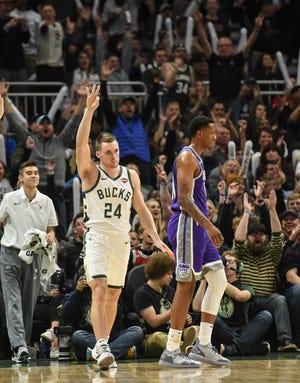 Bucks guard Pat Connaughton reacts after scoring a three-point basket in the third quarter against the Sacramento Kings Sunday afternoon at the Fiserv Forum.