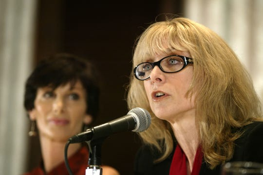 Porn actress Nina Hartley (R) speaks as former porn actress and co-founder of AIM (Adult Industry Medical) HealthCare Foundation, Dr. Sharon Mitchell (L), looks on during an AIM press conference on the outbreak of the HIV in pornographic entertainment industry in 2004.