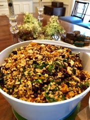 Fall Wheatberry Salad is a healthy mix with greens, cranberries, raisins, sweet potatoes and feta.